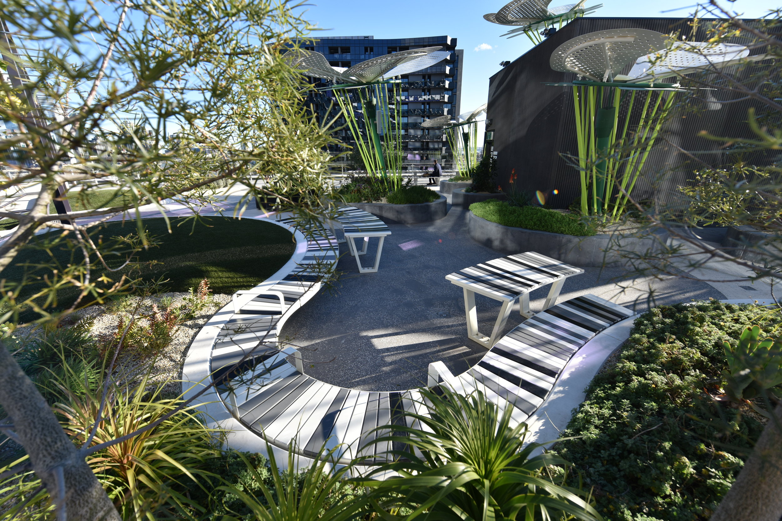 All the landscape spaces were designed around seating opportunities, and to work year-round. Plastic battens were used extensively, for cleanliness and for minimal maintenance. The material has a recycled content, and is available in a wide range of colours. Photo credit: Michael Wright