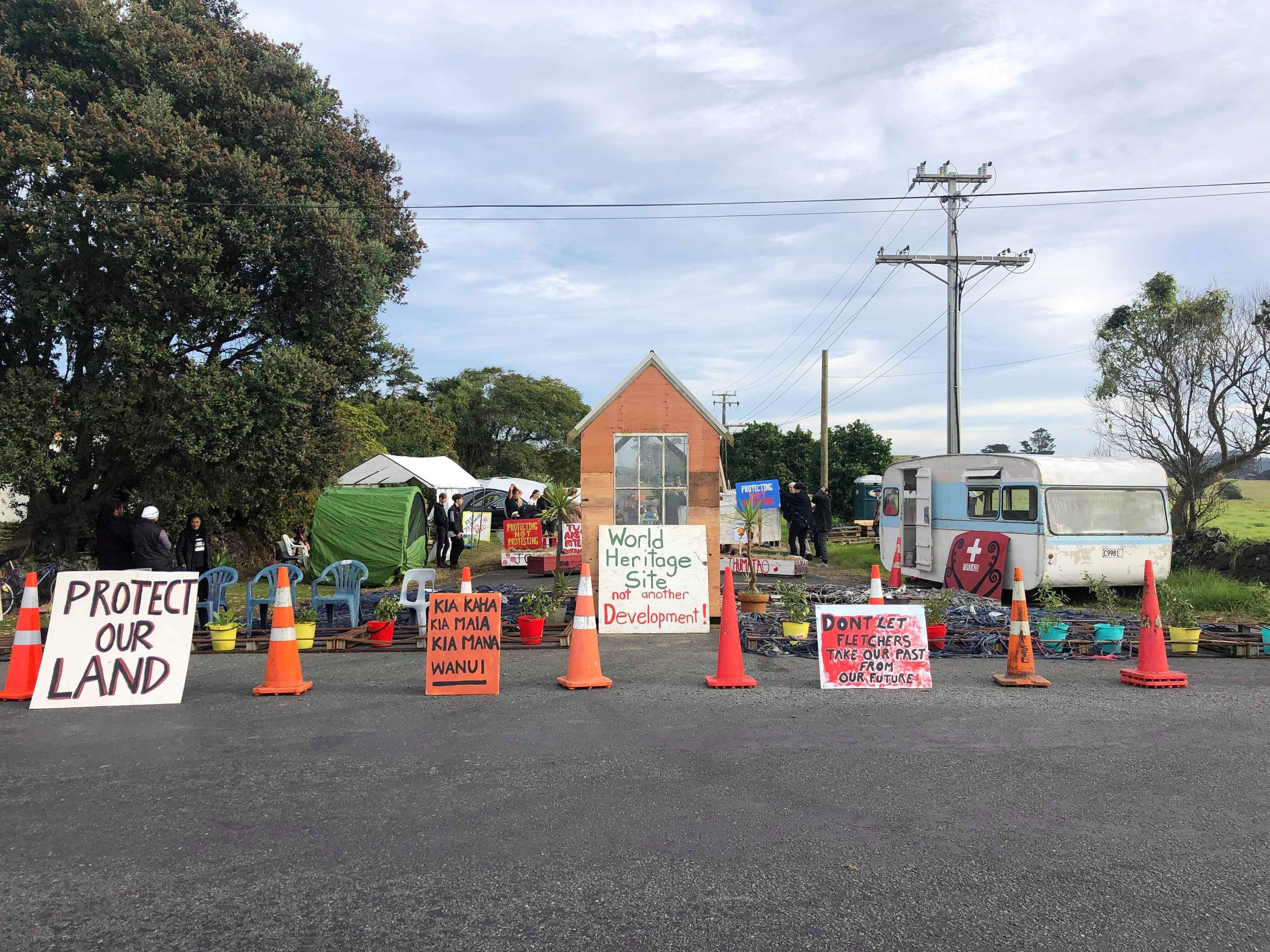 Protestors have been on the road verge at Ihumaatao since 2016, trying to stop the housing development bordering an 800-year-old site rich in Māori history. Photo credit: Tuputau Lelaulu