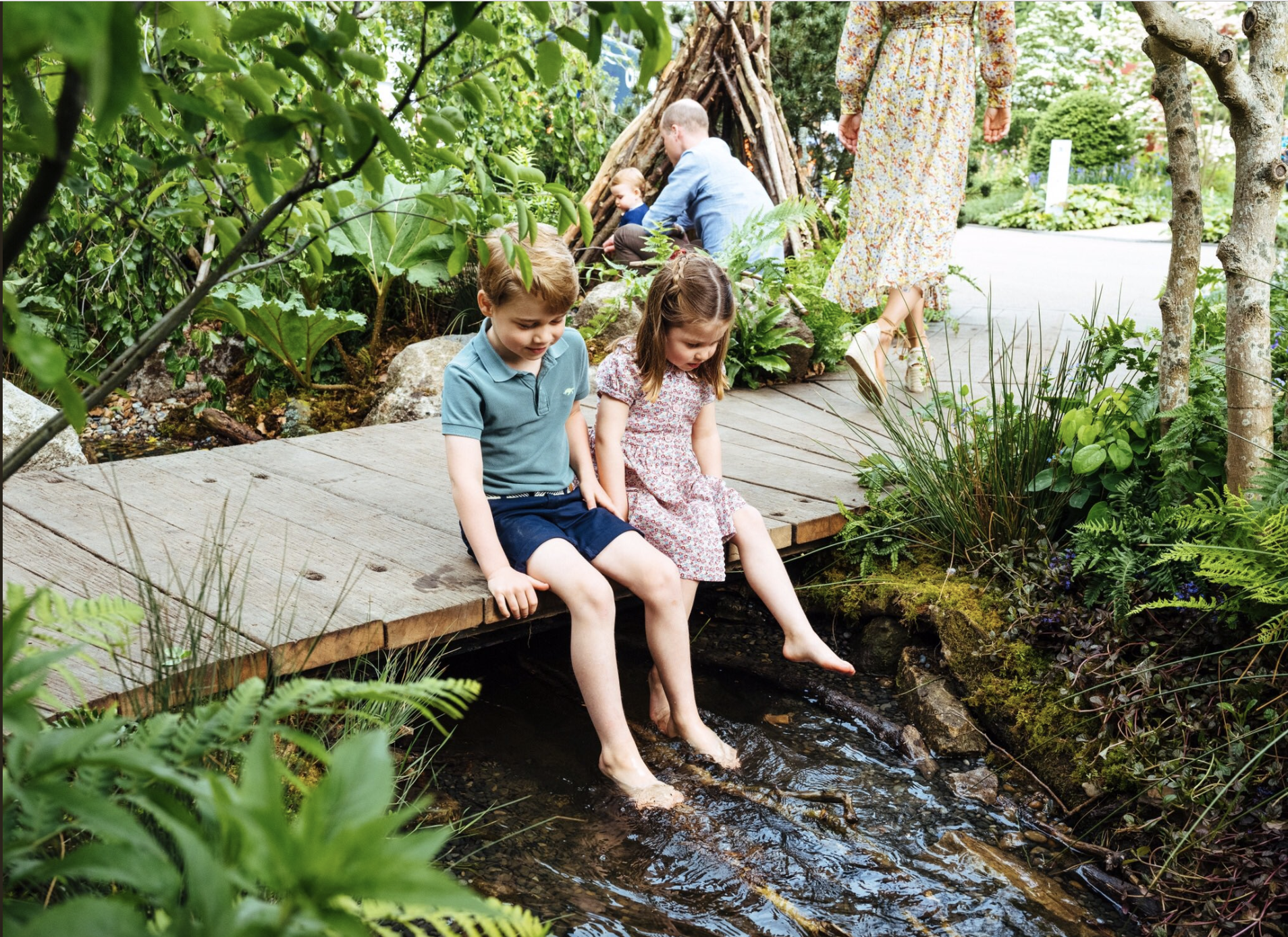 Prince George and Princess Charlotte take in their mother's garden design. Photo credit: Matt Porteous/Kensington Palace