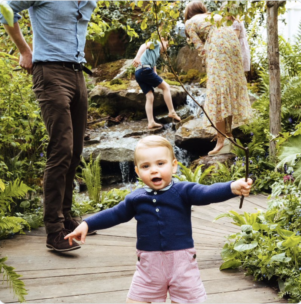 Prince Louis seems particularly happy with the garden. Photo credit: Matt Porteous/Kensington Palace