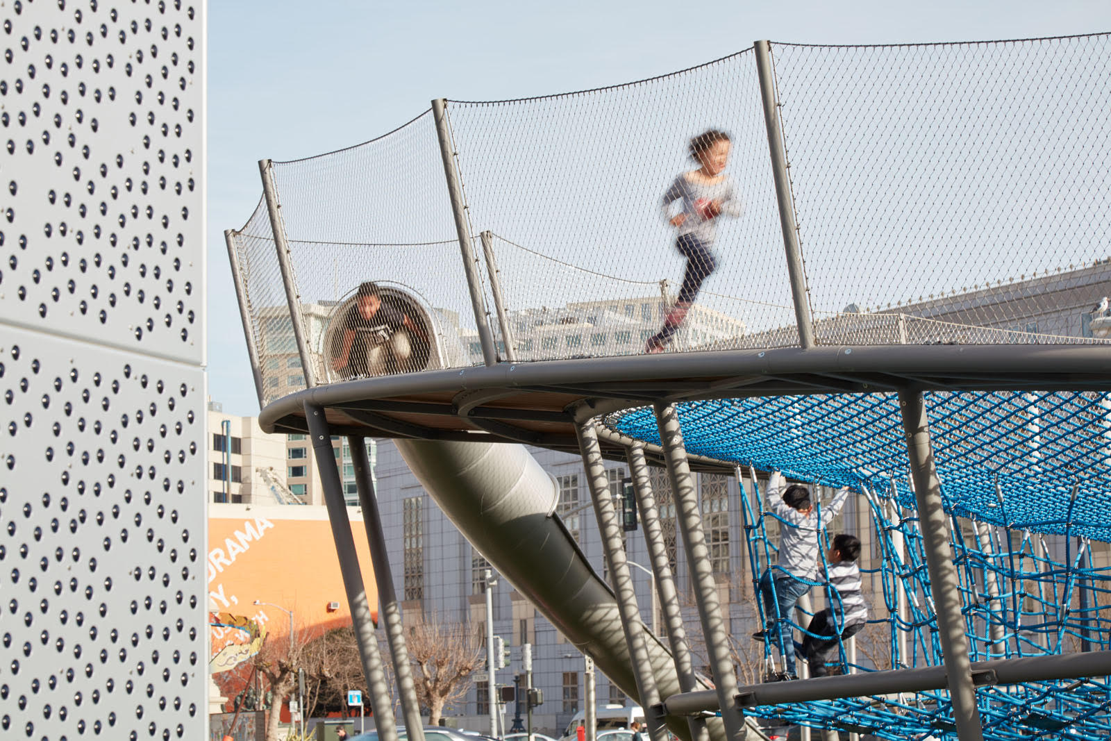 The playground is a great place for city kids to burn off energy. Photo by Bruce Damonte.