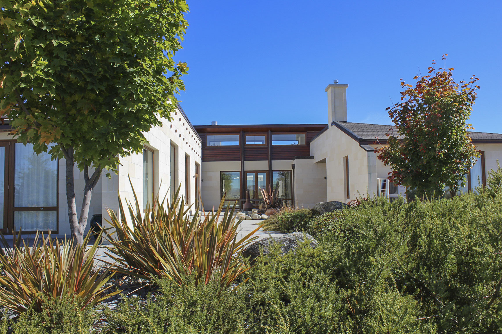 Planting and hardscape materials were selected to complement the Oamaru stone and timber on the building.JPG