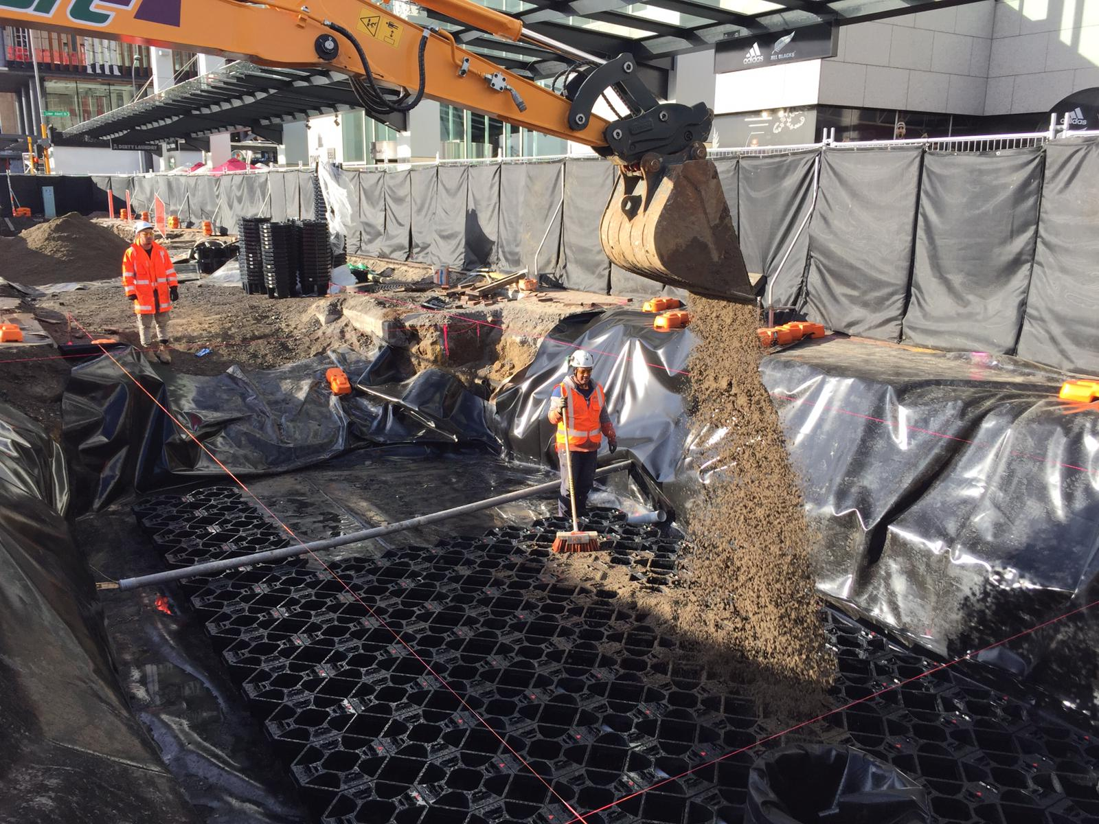 Downtown Programme crew installing the rain gardens