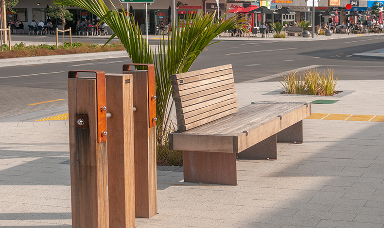Street furniture uses a palette of Corten steel and Tonka hardwood, both materials used regularly in marine environments.