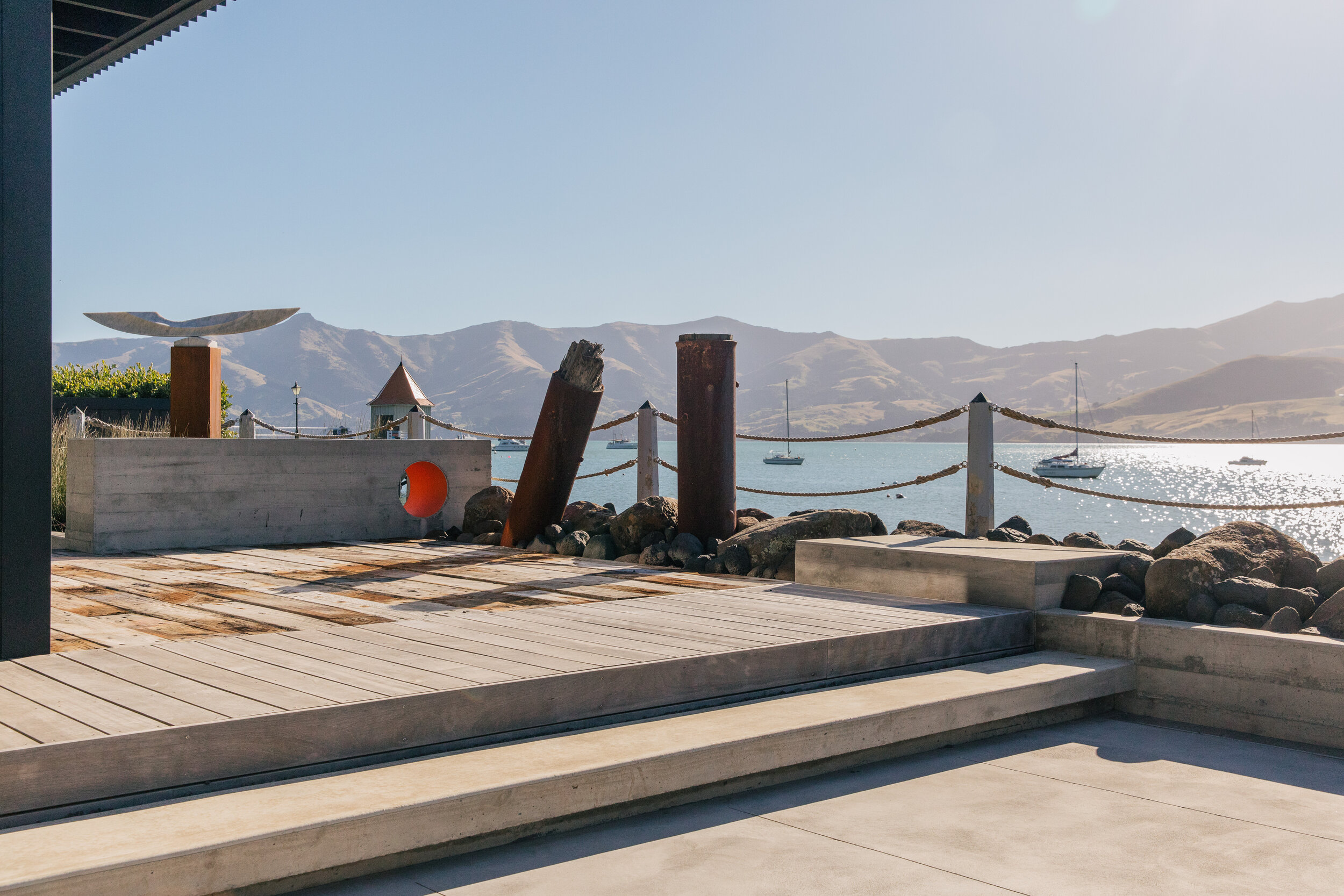 Xteriorscapes took special trips to Lyttelton Port to hand-pick recycled timber features with the clients, and chose local boulders from a nearby farm.