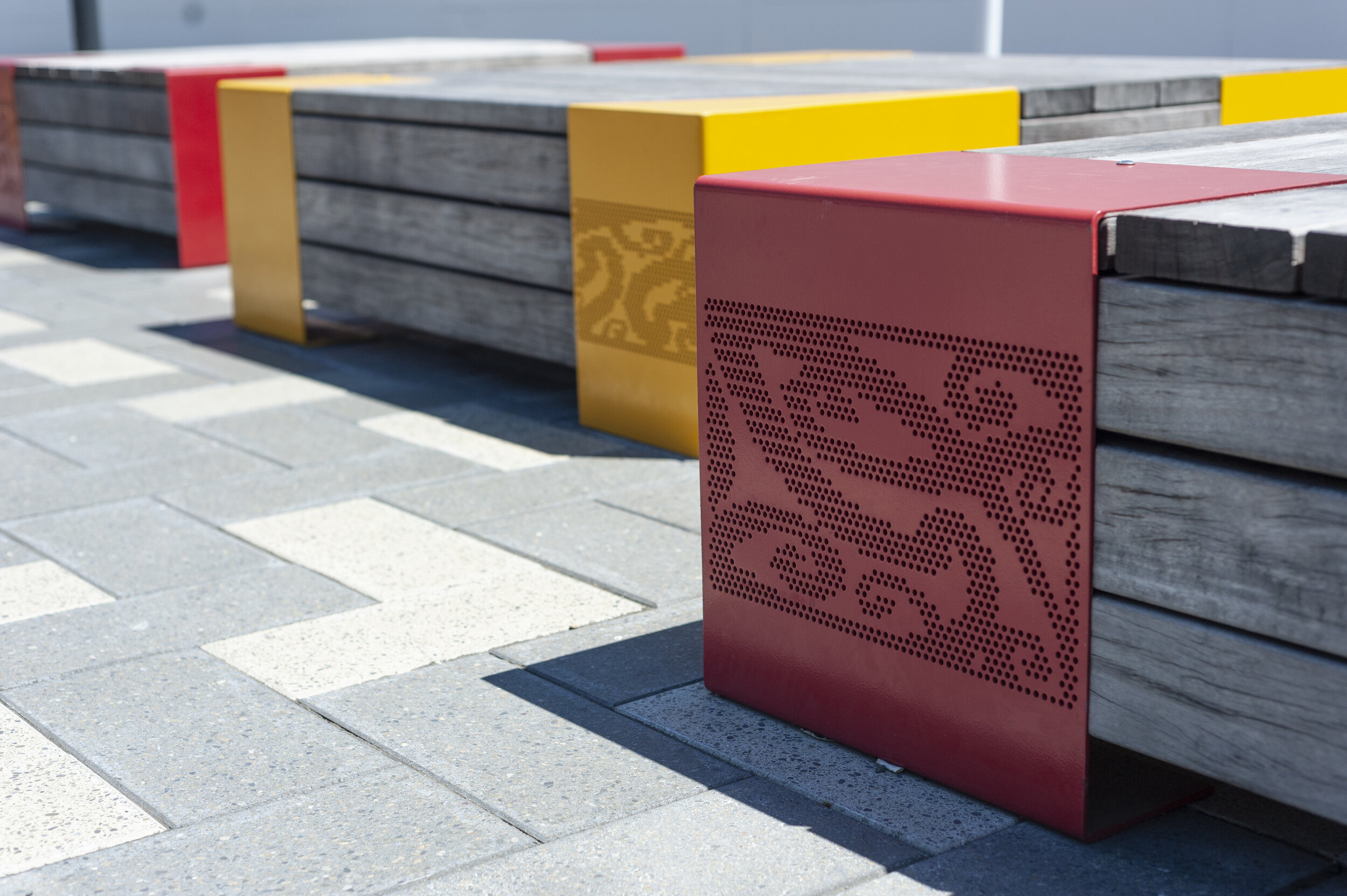 The colour of the street furniture is bright, referencing the community's preference for such colours to offset the climate.