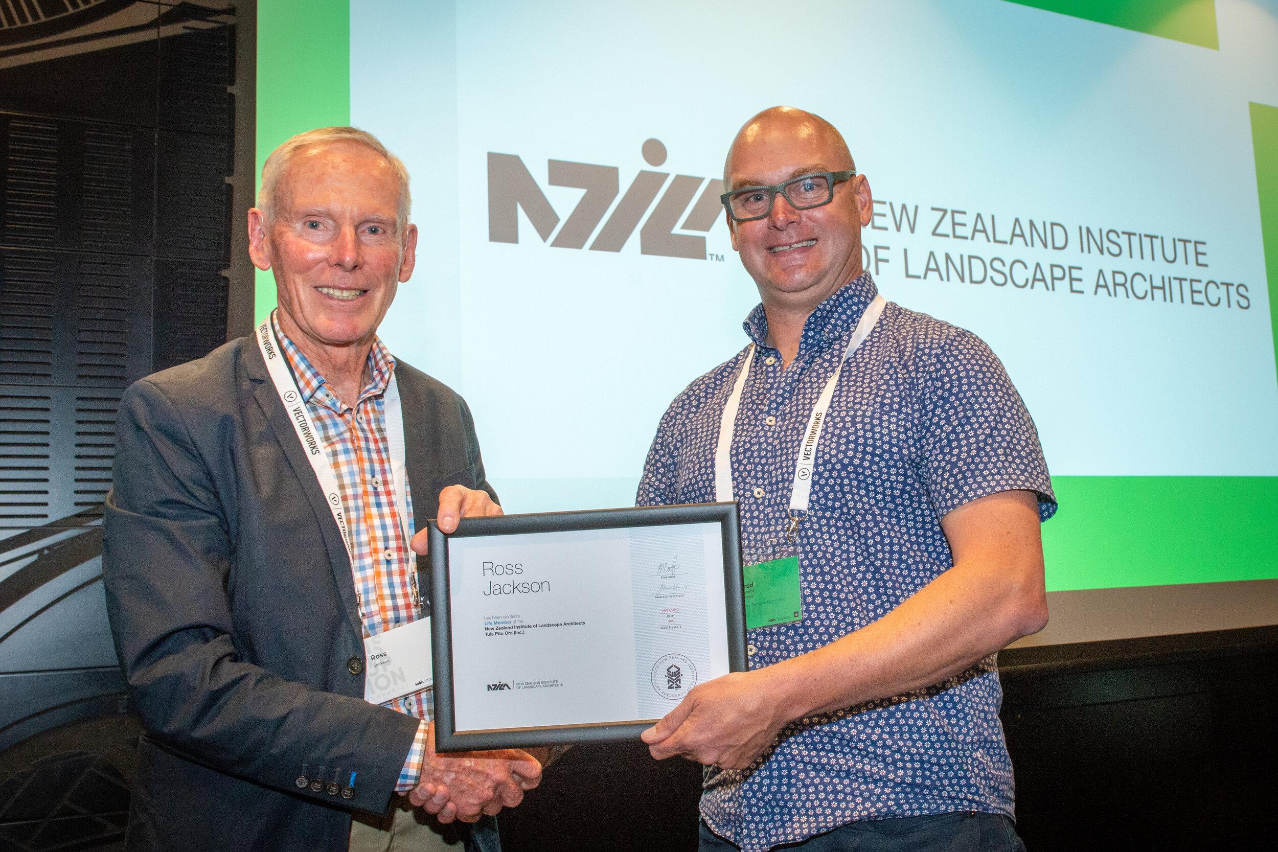 NZILA President Brad Coombs presents Ross Jackson with his life membership.