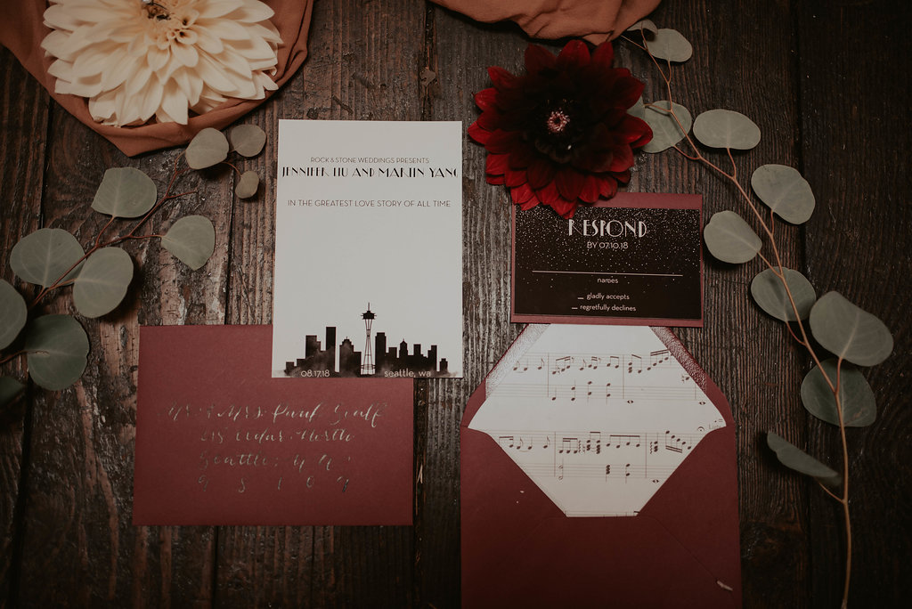The stationery from  Love Fern Design  featured the Seattle skyline, teamed with the Lala Land movie poster font, and because no detail was left undone the envelope liner even featured sheet music from 'City of Stars'.