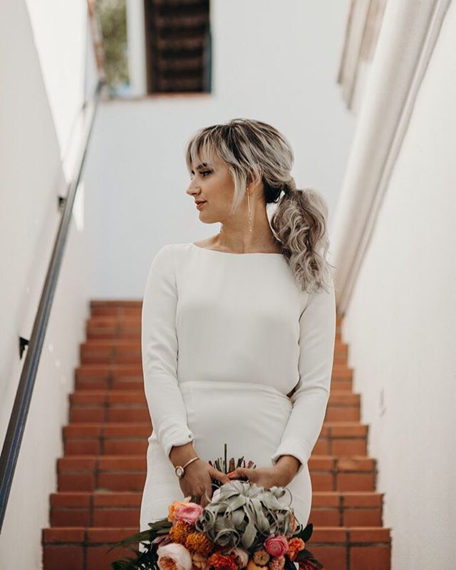 Nothing says fierce like 3 outfit changes! Here's the stunning @histephrogers in her ceremony look. She walked solo down 3 flights of steps to arrive at her ceremony like a badass Disney pop punk princess.. while Taylor Swift's Enchanted blared out and there wasn't a dry eye in the house... 😭 also, is it me or are pony tails the new updo? @pacific_brides nailed it! . . Photography @carleyjaynephotography  Planning/design @rockandstoneweddings  Hair @pacific_brides  Make up @lisungoh  Gown @houghtonnyc  Florals @brierandivy  Cake @amber_markland Stationery @loveferndesign  Entertainment @coachtaylor  Venue @wrigleymansion  Bride & Groom @histephrogers @captain_tyin_knots . . . . . . . . #bombassbride #badassbride #bohobride #coolbride #bridalhairstyles #indiebride #bridalbouquet #arizonabride #phoenixwedding #weddingplanner #seattleweddingplanner #seattleweddingphotographer #indiewedding #pnwedding #happilyeverwild #weddingchicks #rockmywedding #rocknrollbride #wedventuremag #elopementwedding #northwestcreatives #dirtybootsandmessyhair #destinationweddingplanner #seattleweddingplanner #bridetobe2018 #engaged