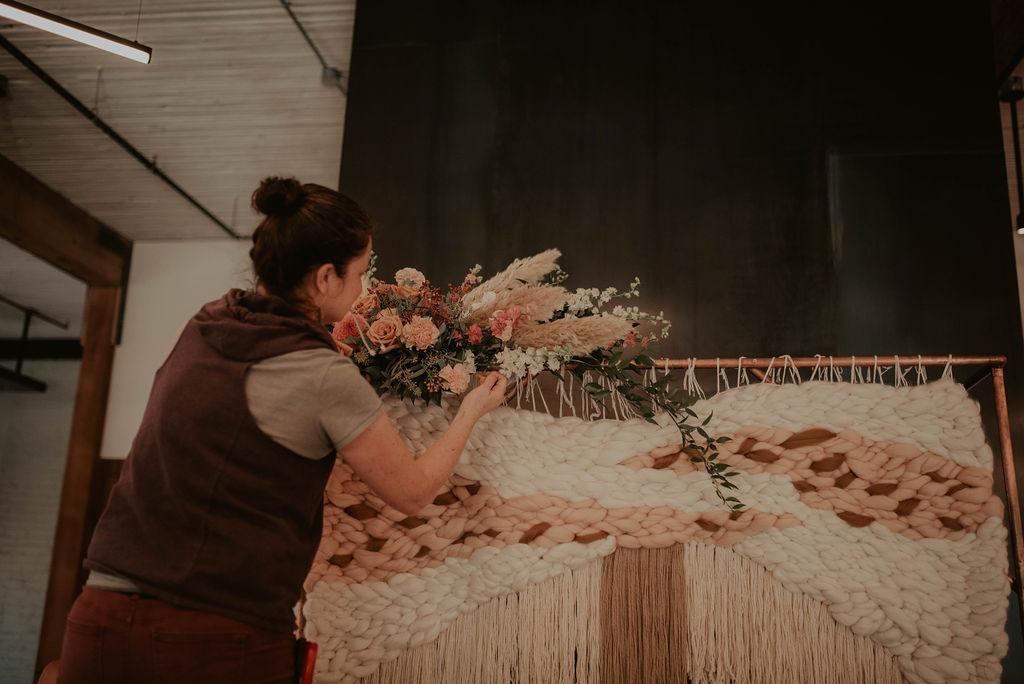 Seattle wedding florist  Colibri Blooms  erecting a ceremony backdrop  Photo credit:  Kendra K Photo
