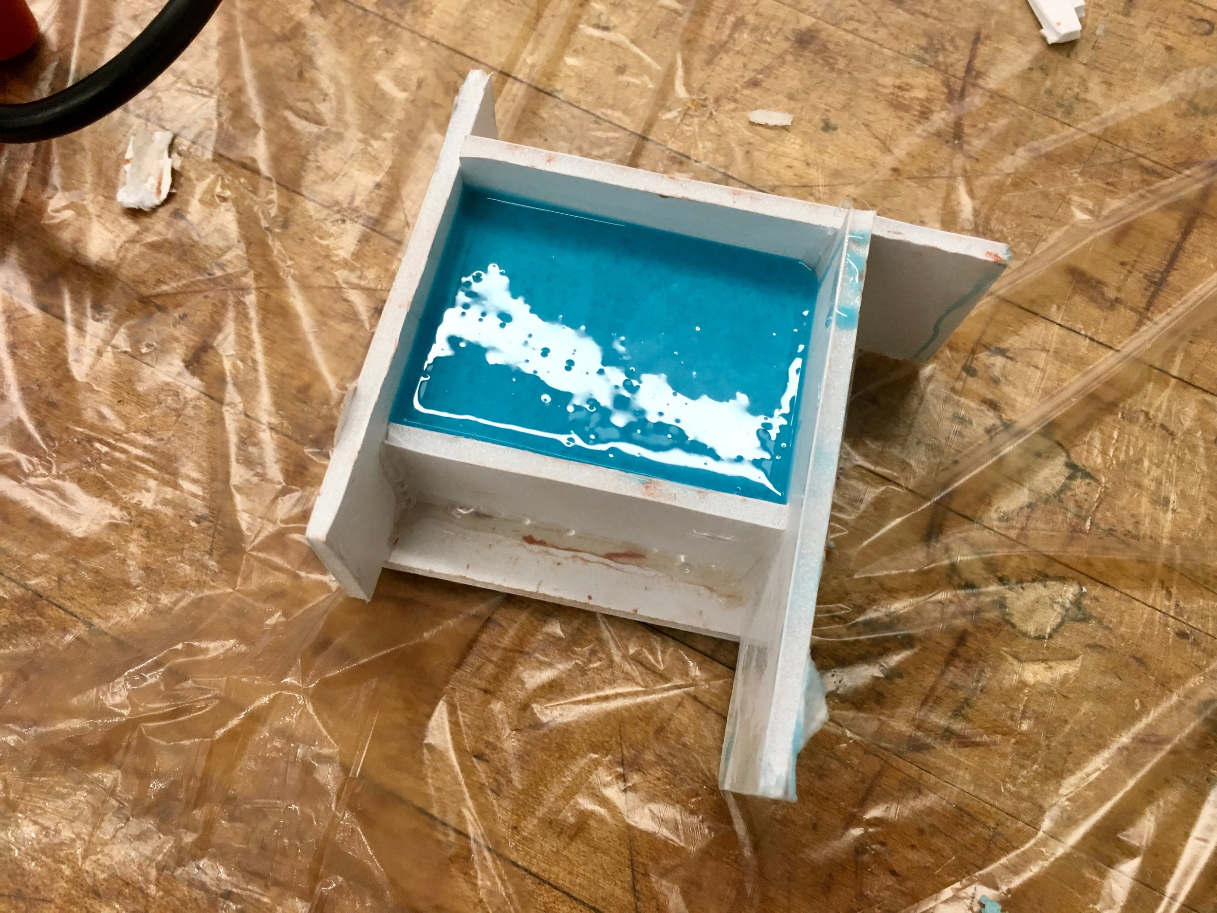 First part of mold mixture poured.