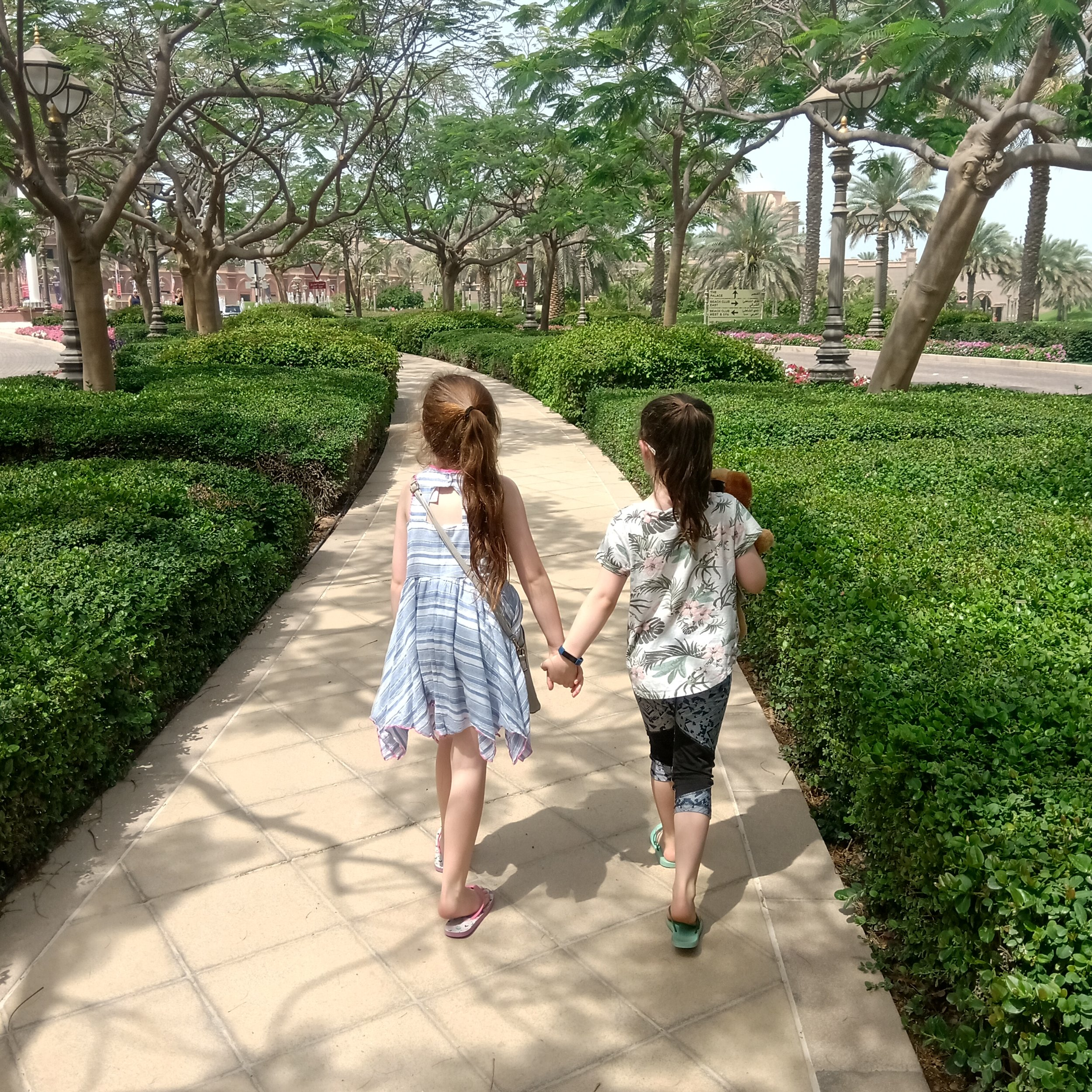 Emily (right) and her besty, Alayna, strolling through the Emirates Palace grounds