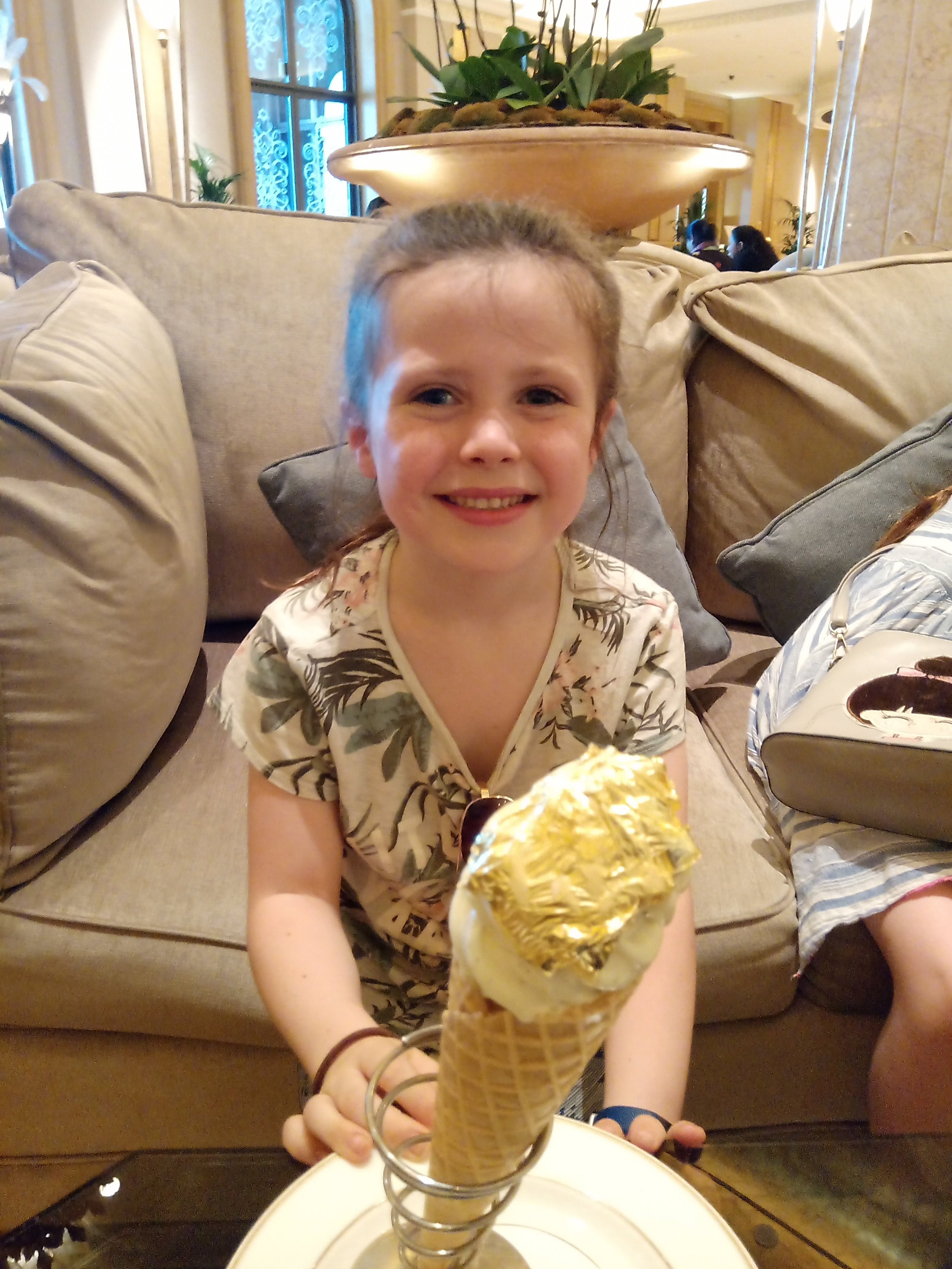 Emmy semi-enjoying her ostentatious dessert