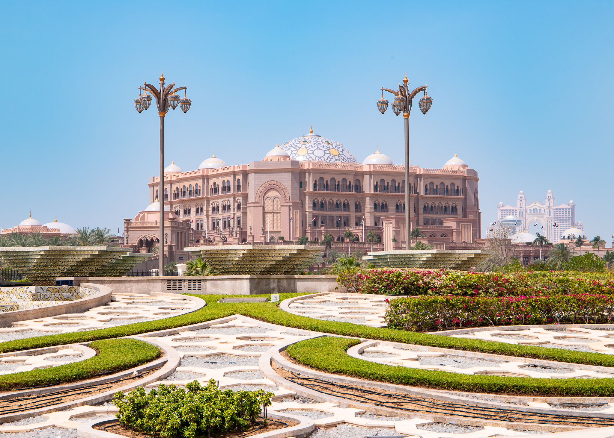 The Emirates Palace glittering amidst the dust and haze
