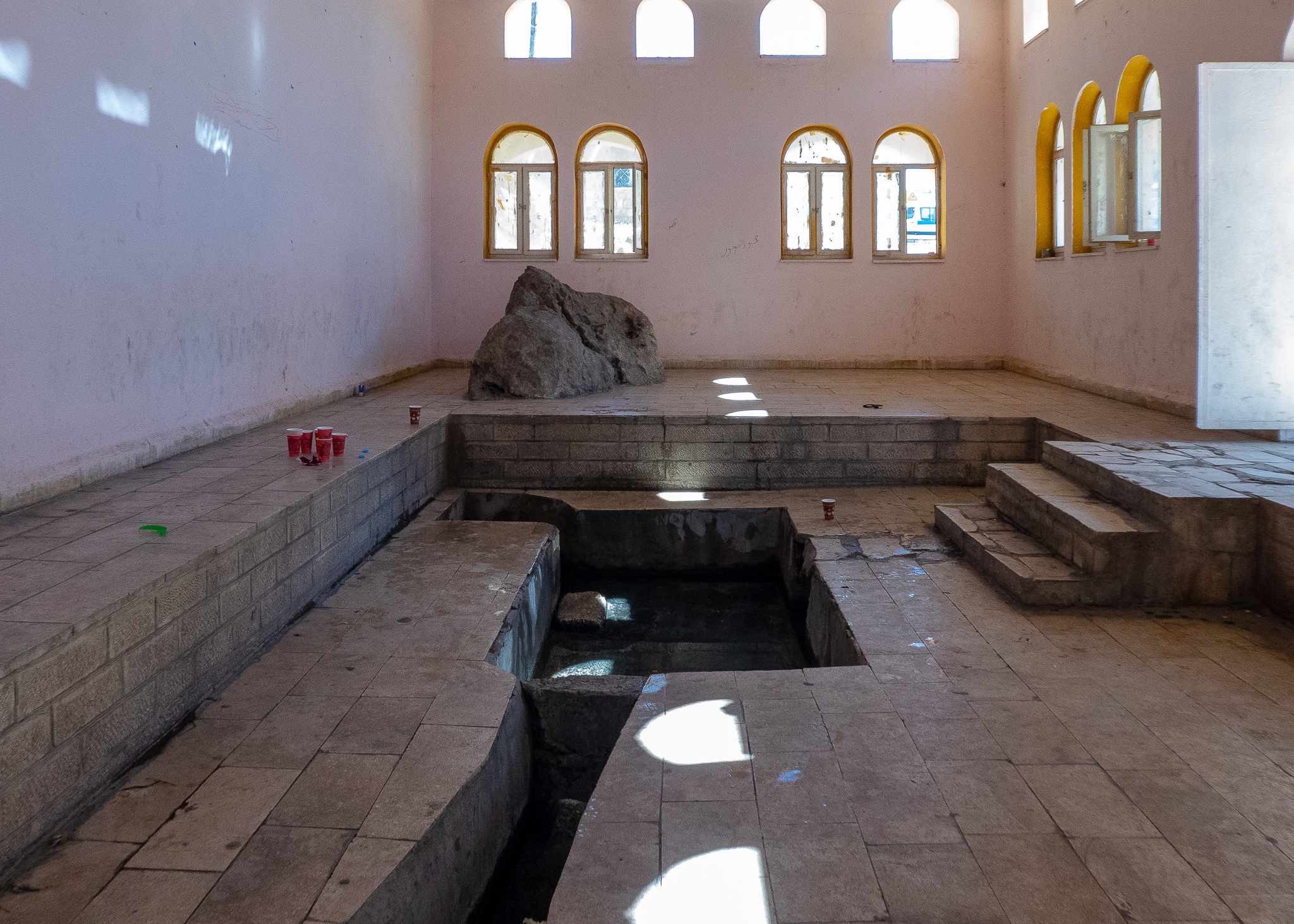 Water still flows inside and I'm guessing that rock is symbolic, rather than being the one Moses struck