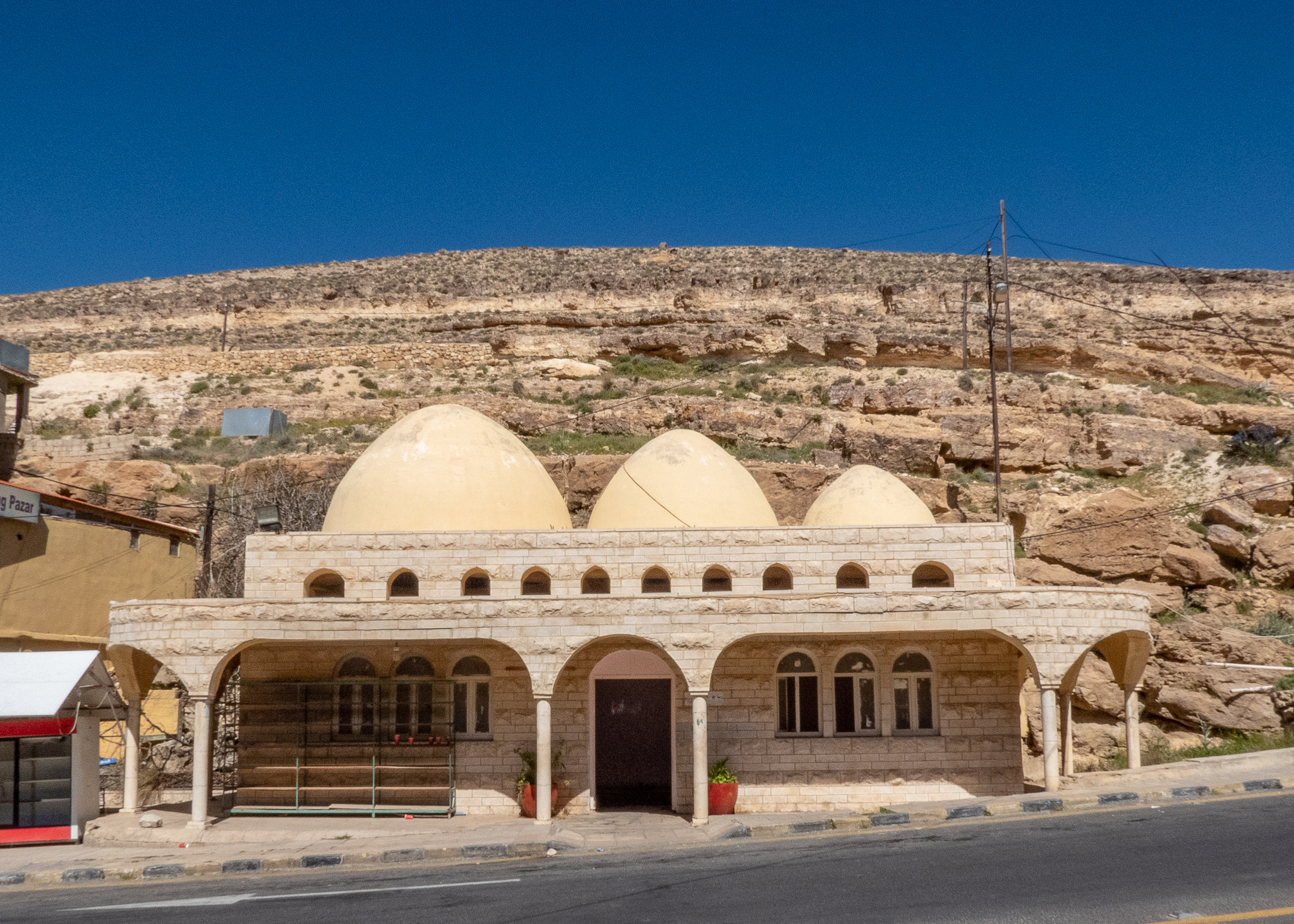 The unique three domed housing structure makes it reasonably easy to find Mousa's Spring