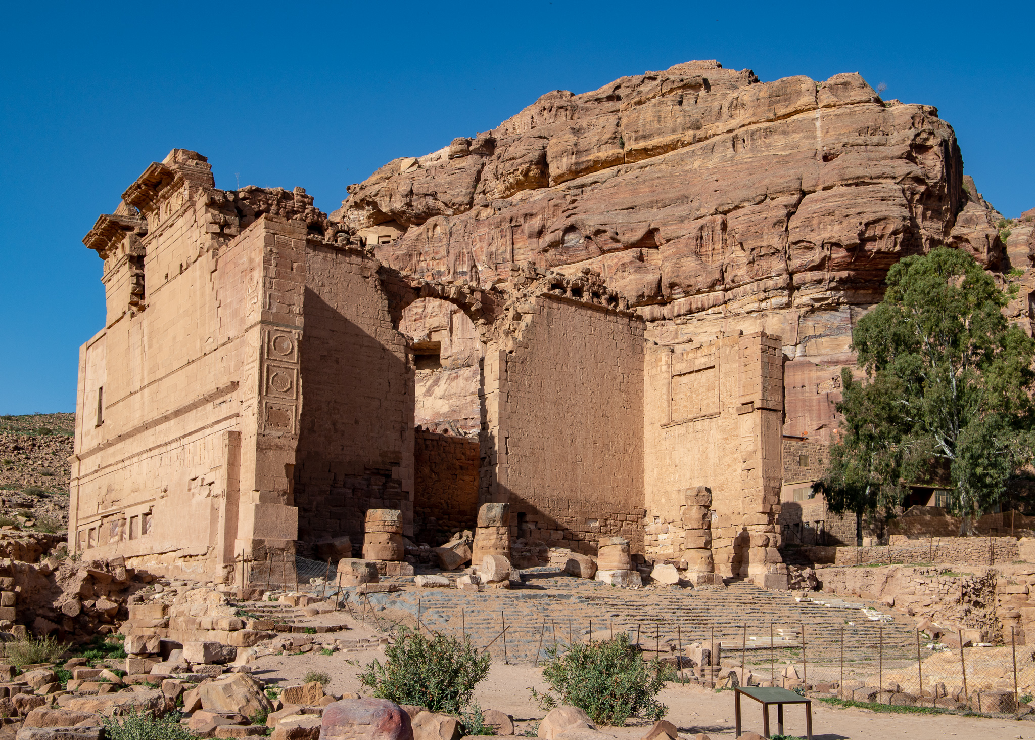 Seemingly dwarfed by the mountain behind, the Temple of Dushares still has the largest front of any building in Petra