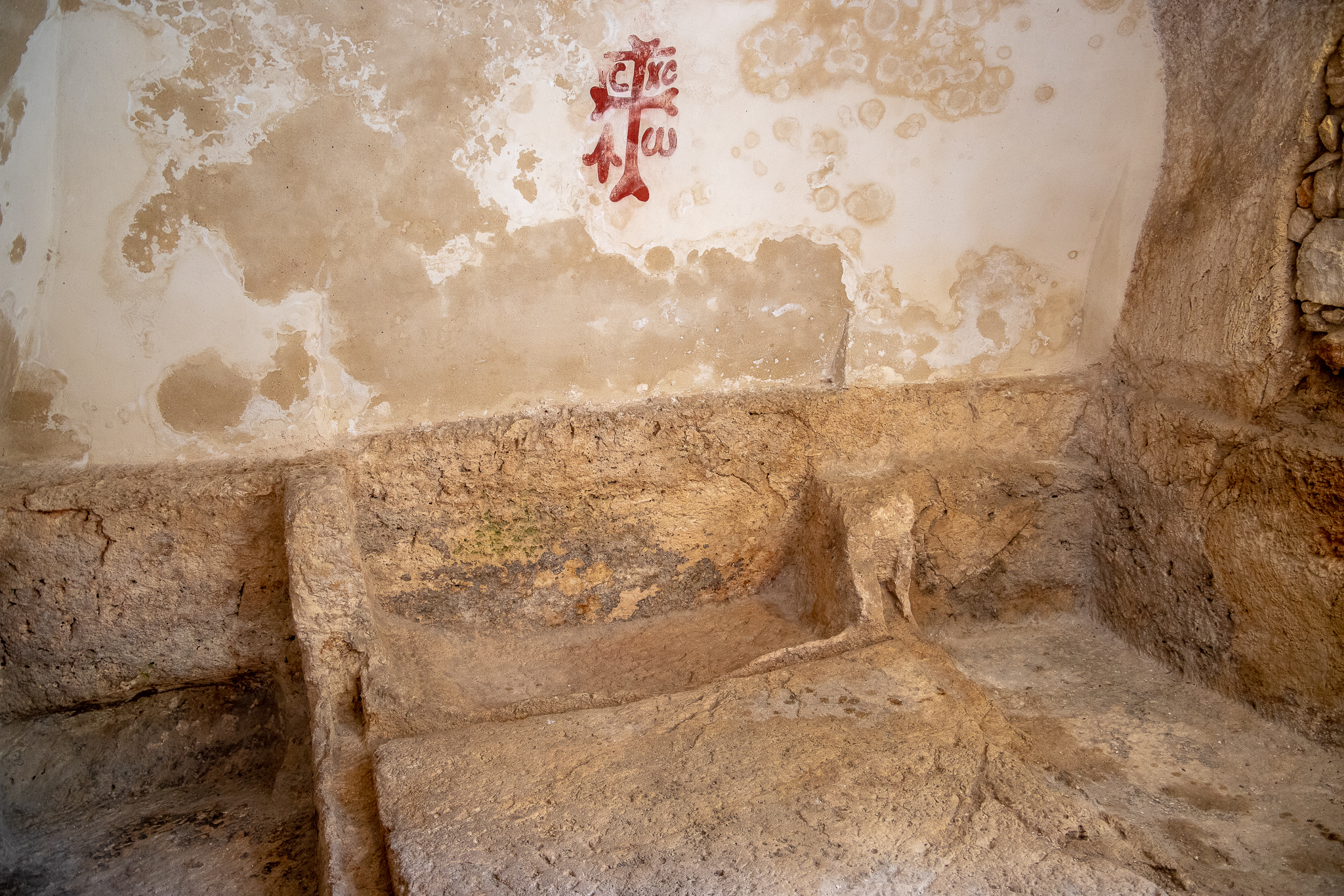 Inside the tomb with Byzantine cross grafiti