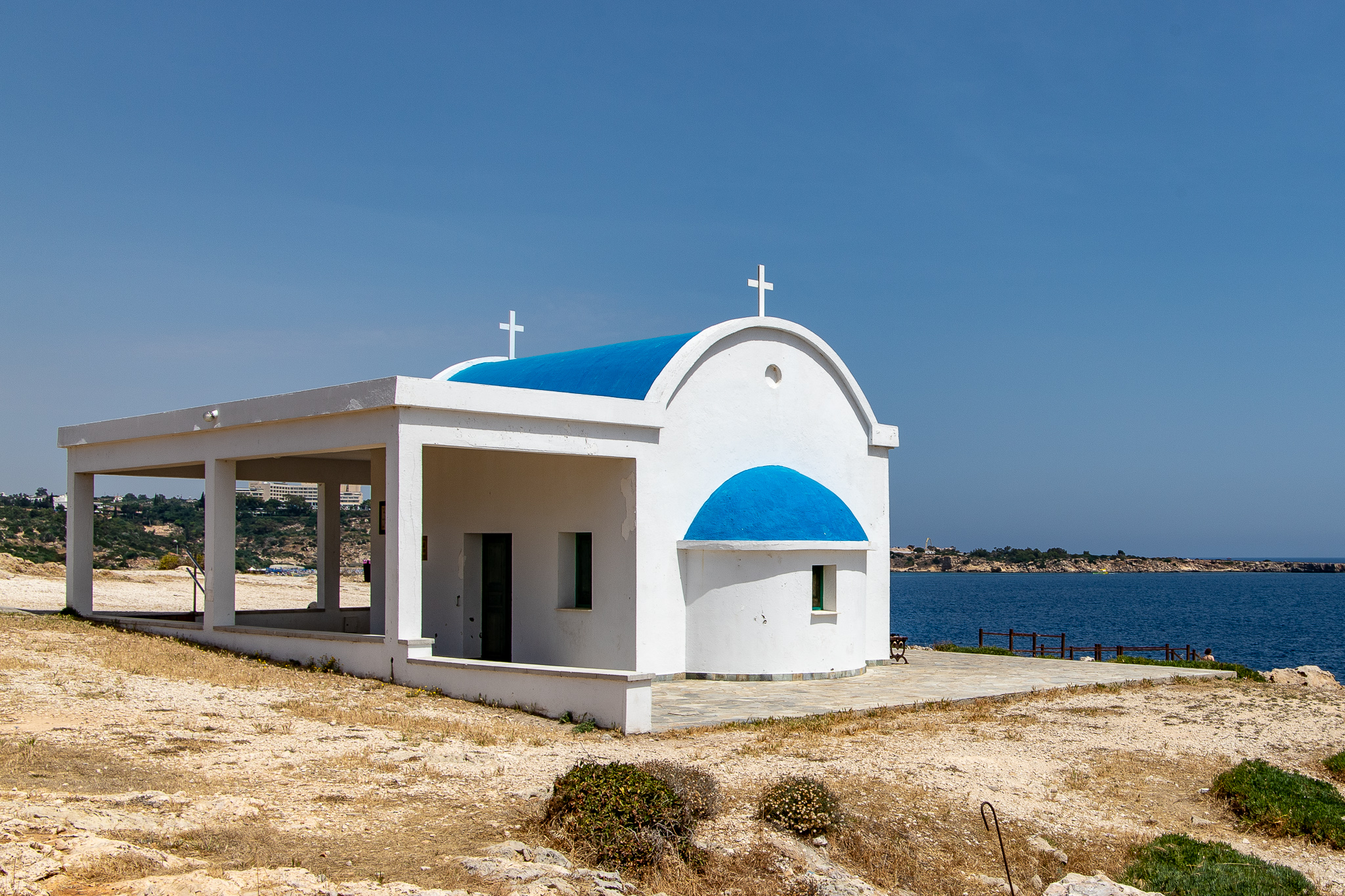 The Agioi Anargyri Church idyllically situated above some sea caves