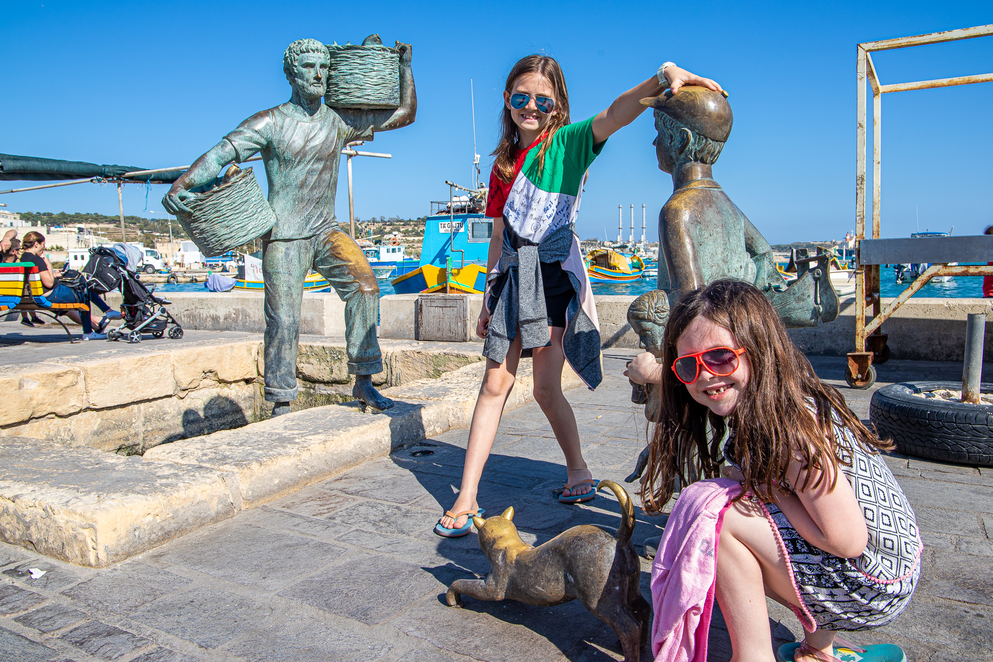The girls playing with their bronzed friends on the waterfront