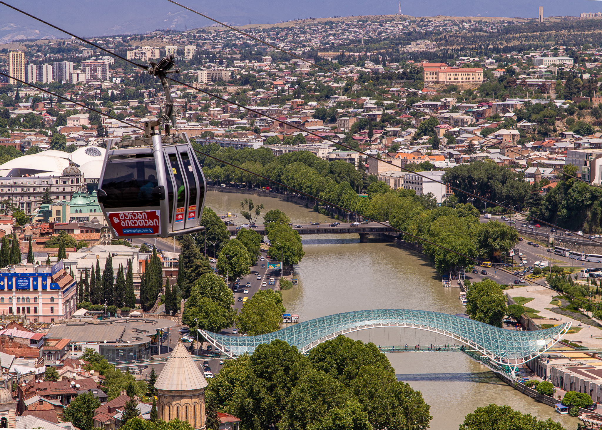 The Aerial Tramway floating above the Bridge of Peace