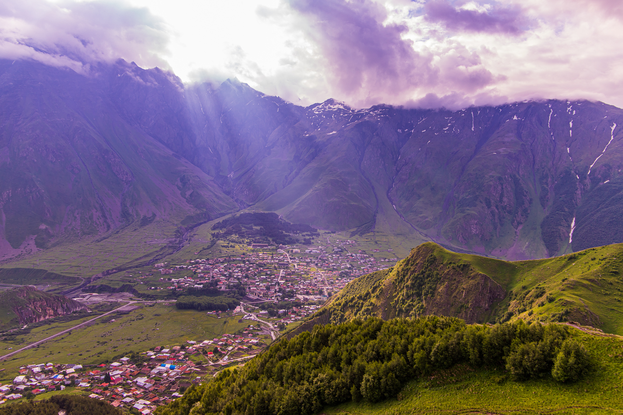 Early morning rays shining down on the town of Stapantsminda