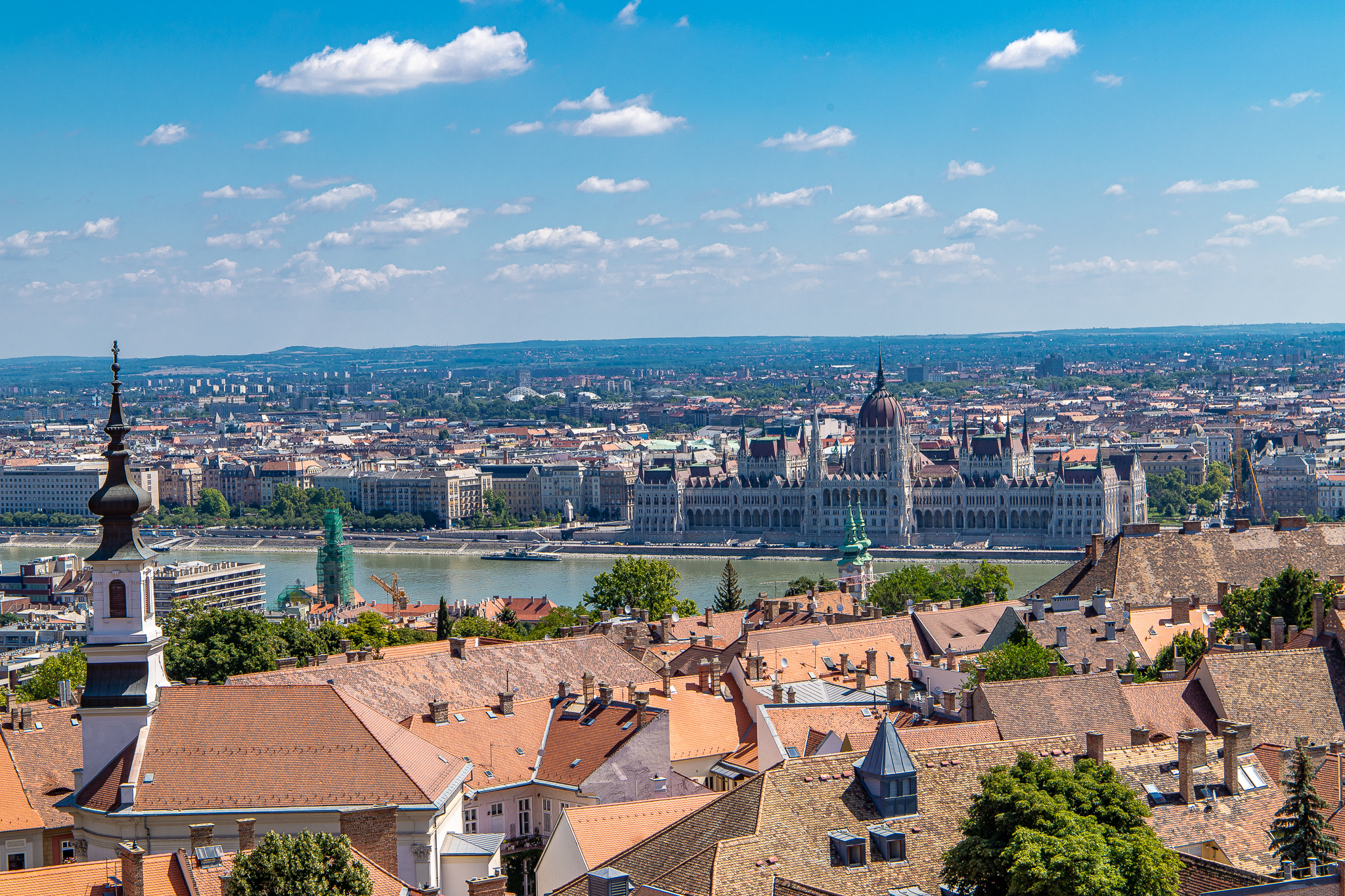 Views across Castle District rooftops to the Danube River and Hungarian Parliament Buildings