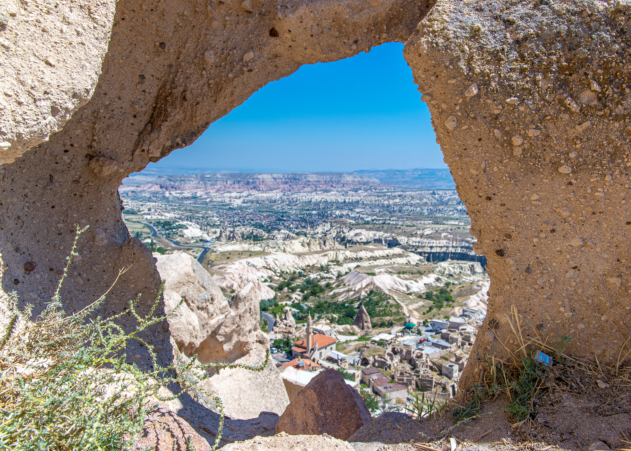 View down to Uchisar town and Goreme off in the distance