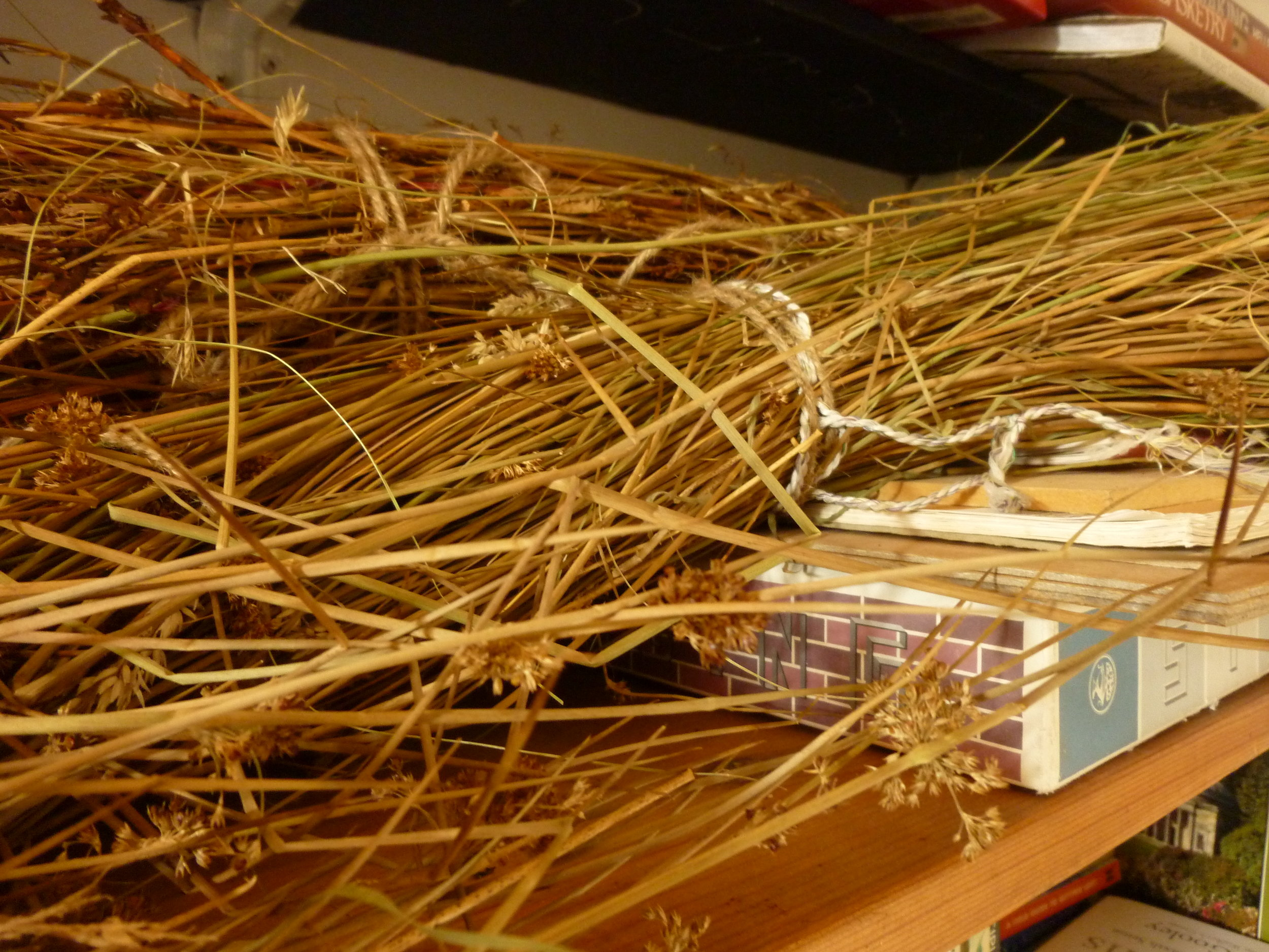 Translating wild grasses into...(tba)   Those abundant garden grasses much loved by the Hebridean wildlife are now dried, and ready for working. If only I had some time to weave…