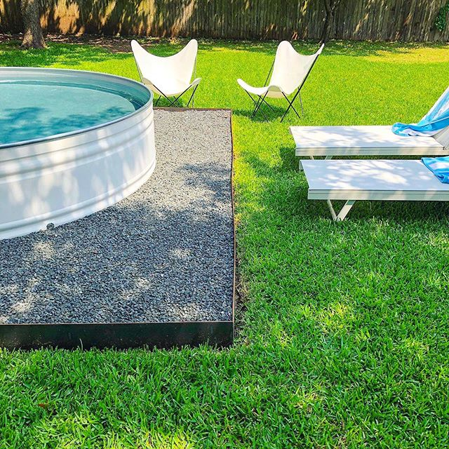 Tag a friend 👉 to lounge with you next to this stock tank pool 😎☀️🙌 📷: @stonewayswimclub  #stocktankpool #stocktank #hillbillyhottub #summer #backyard #backyardpool #lawn #backyarddesign