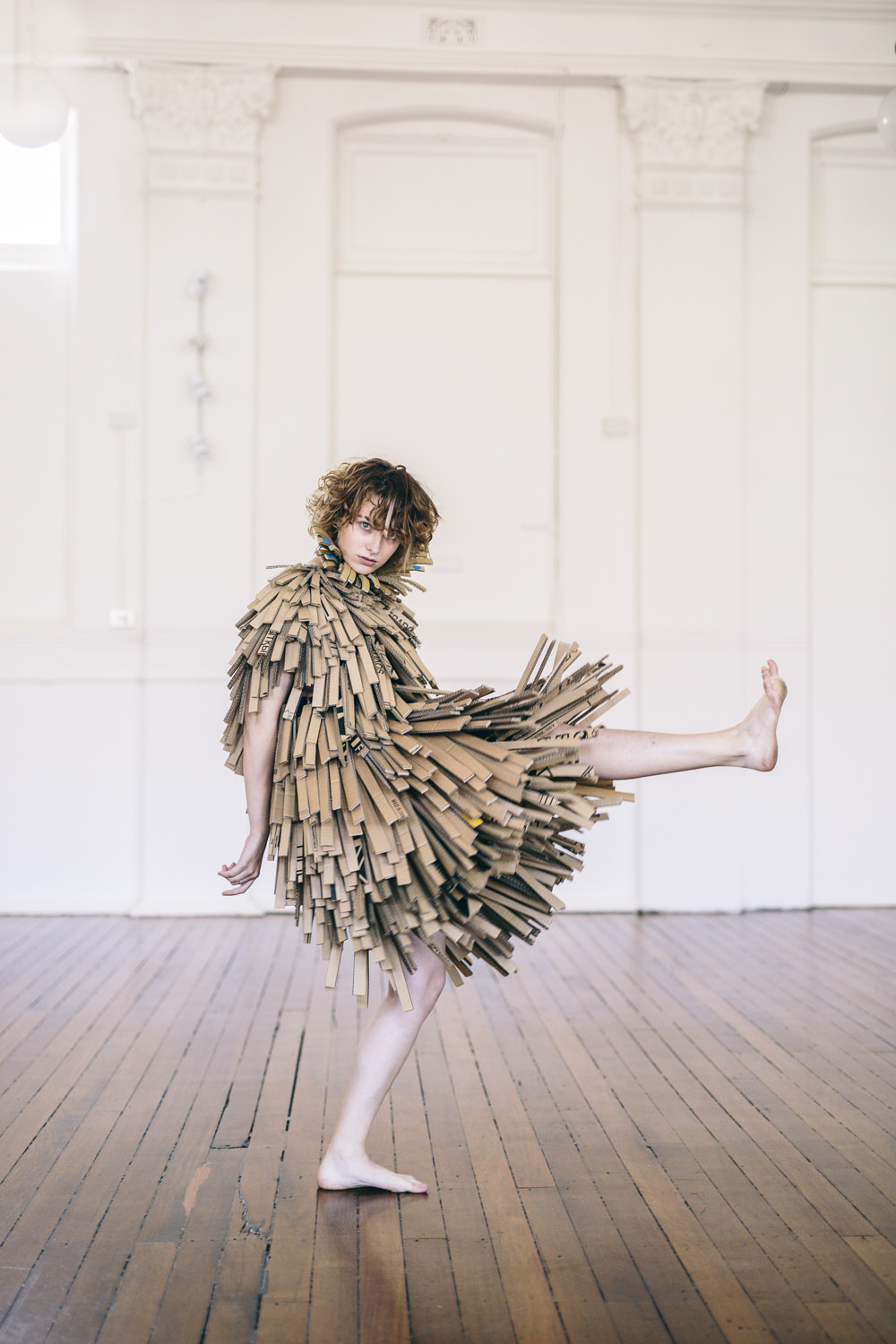 Cardboard Fringe Coat, repurposed cardboard hand stitched to repurposed vest.