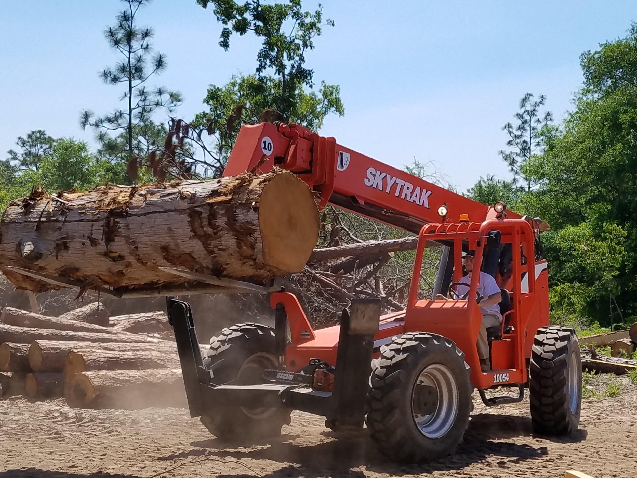 Sky Trak moving cypress log to mill