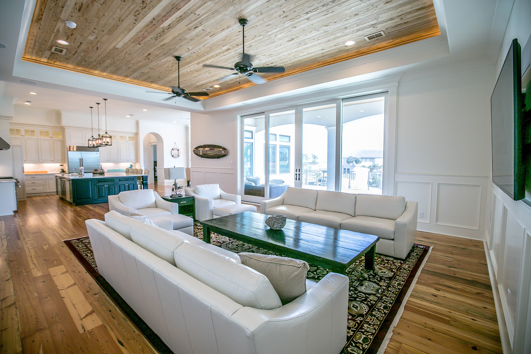 Custom home with reclaimed wood floors and wood planked ceiling inset