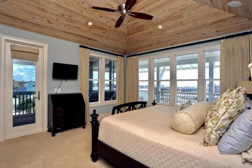 Custom home with wood planked ceiling made out of reclaimed wood