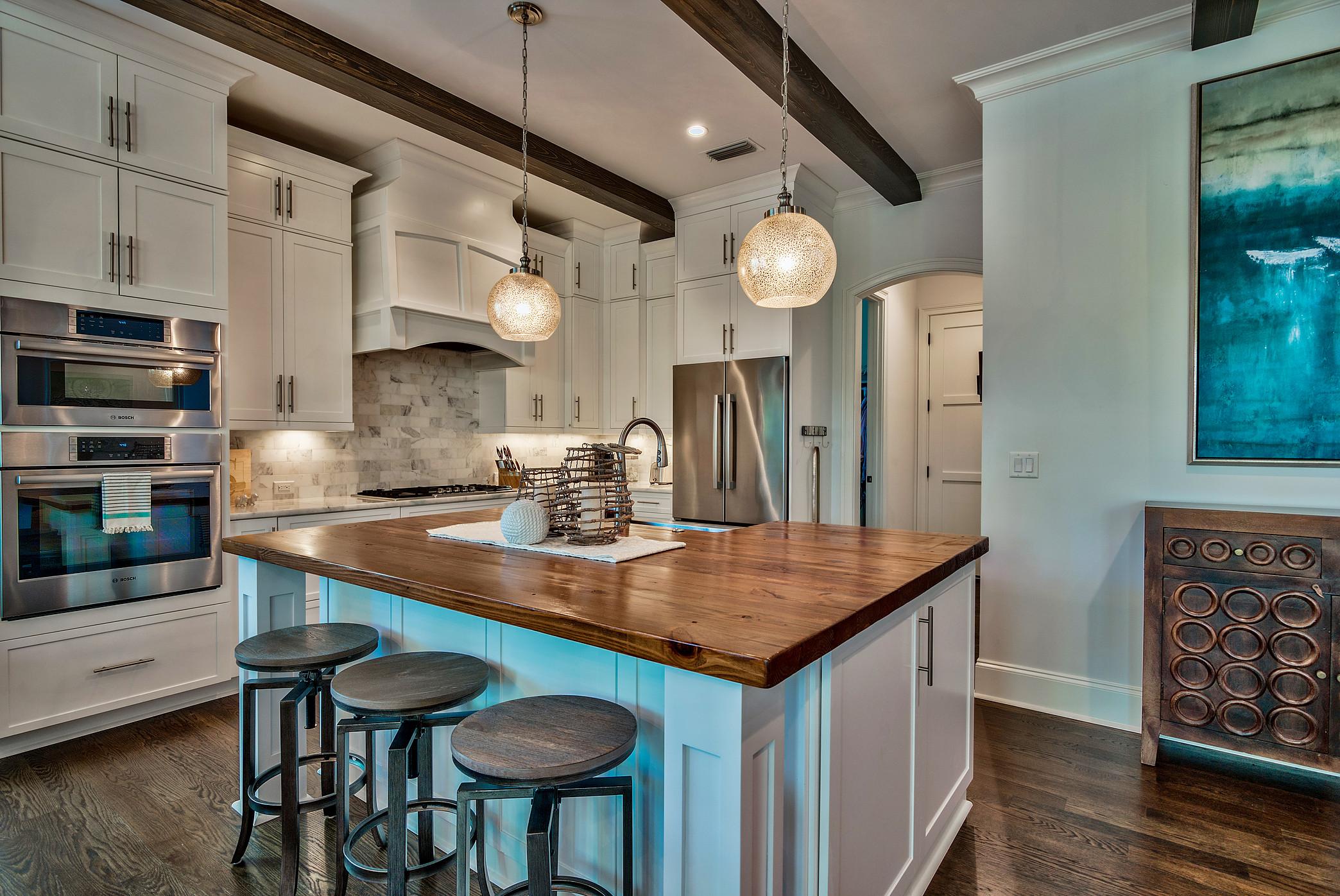 Custom Home with Exposed Wood Beams, Wood Countertop and Hardwood Flooring.