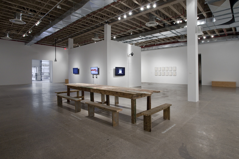 TBD installation view with Maggie Groat's  When Fences Become Tables,  2013 in the foreground.
