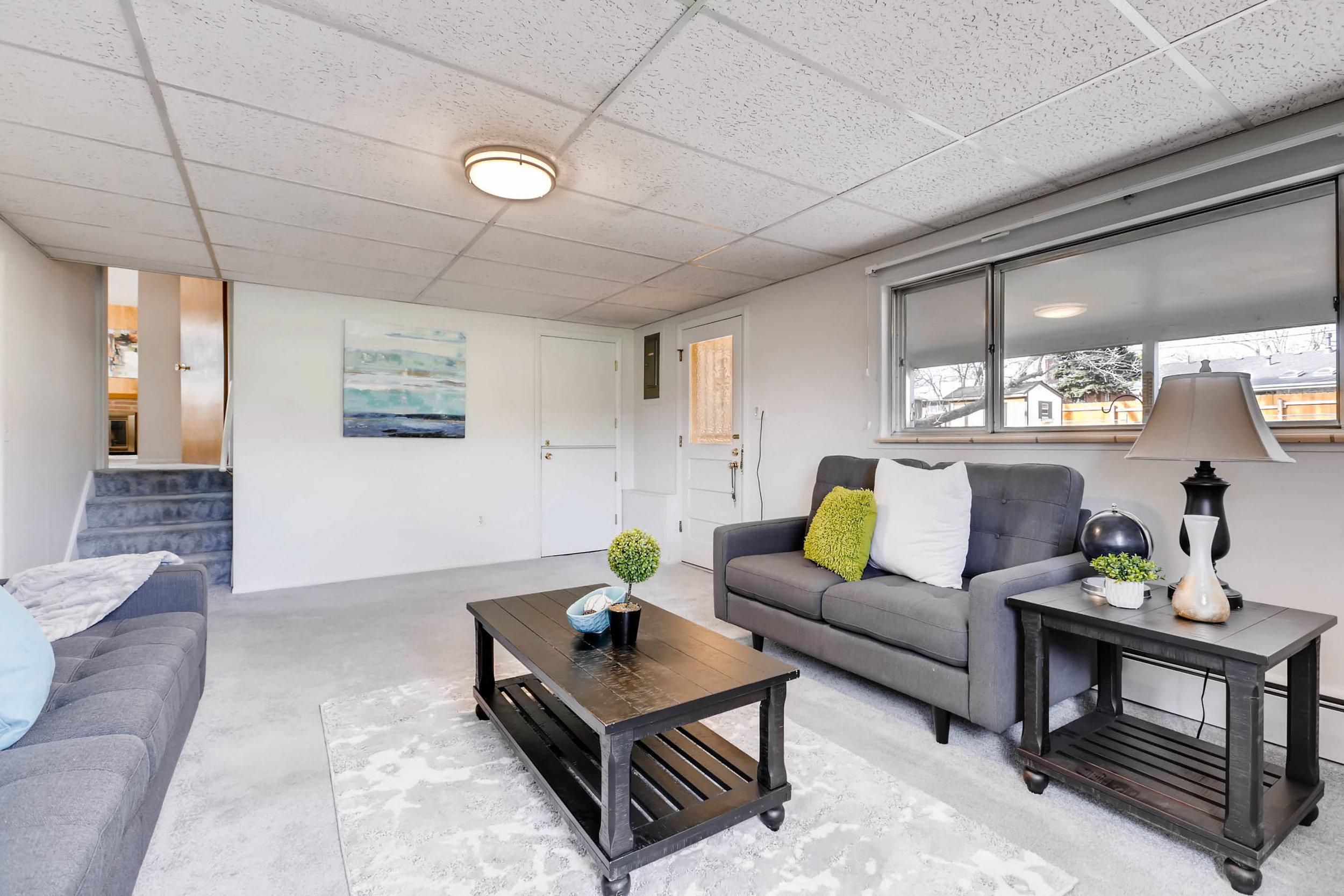1655 S Monaco Parkway Denver-print-022-4-Lower Level Family Room-2700x1800-300dpi.jpg