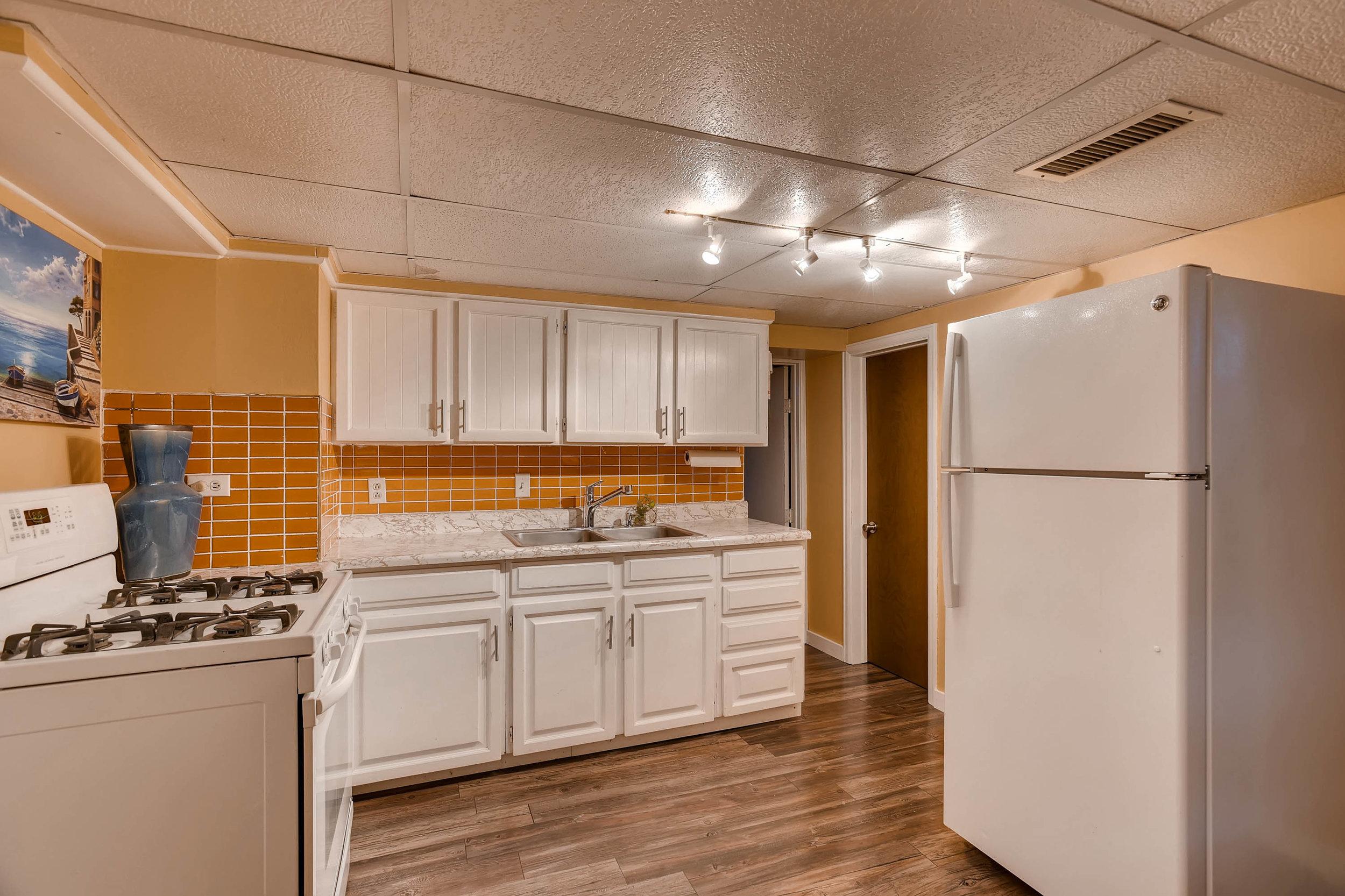 4210 Quivas St Denver CO 80211-print-020-19-Lower Level Kitchen-3000x1999-300dpi.jpg
