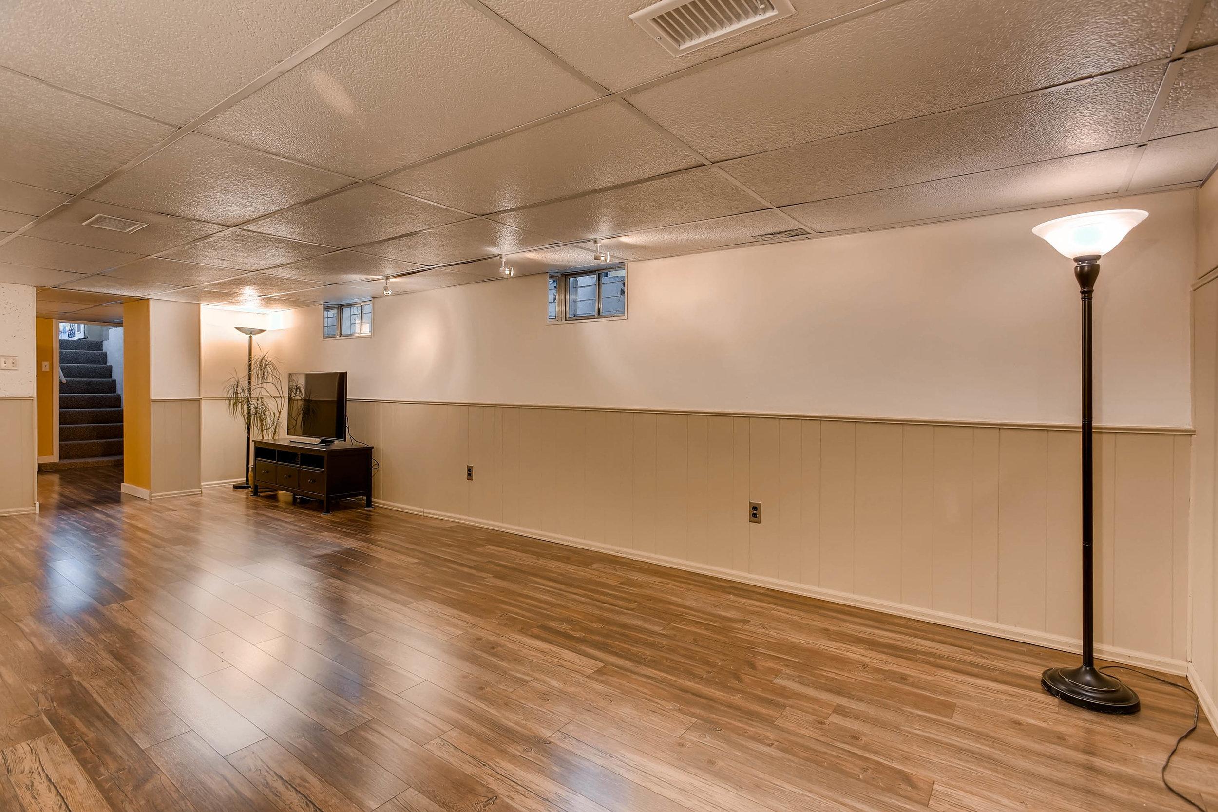 4210 Quivas St Denver CO 80211-print-021-16-Lower Level Family Room-3000x2000-300dpi.jpg