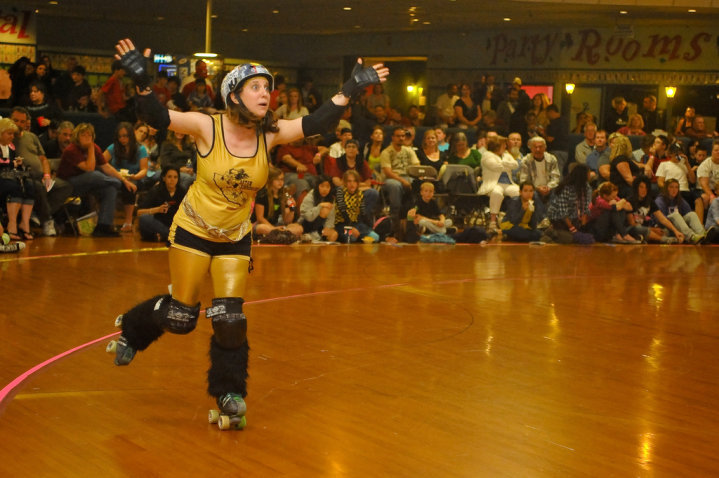 Possibly my favorite outfit I ever wore in a roller derby game and one of my very favorite roller derby photos - answering a question asked by Halee Daily. Photo by Tim Tolle.