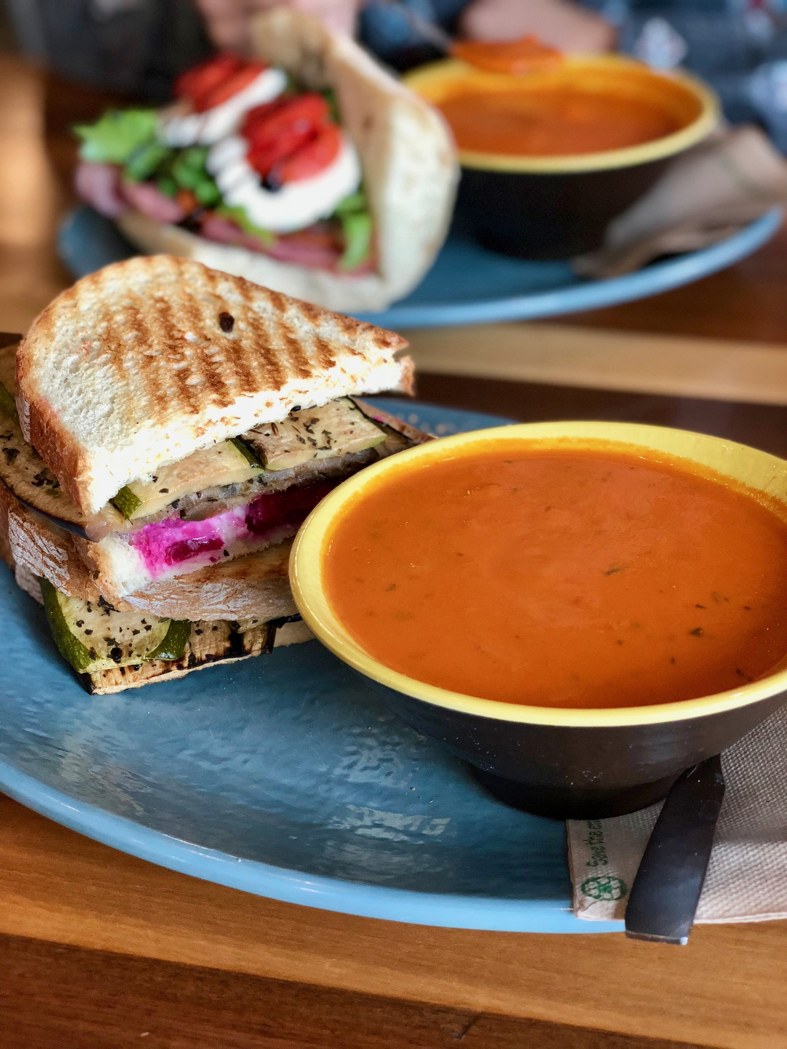 Pressed Ponto sandwich: roasted veggies ((like zucchini and eggplant)) with beats and feta ((you can opt for no feta if you are Vegan)) smothered in garlic aioli; plus a tomato bisque.