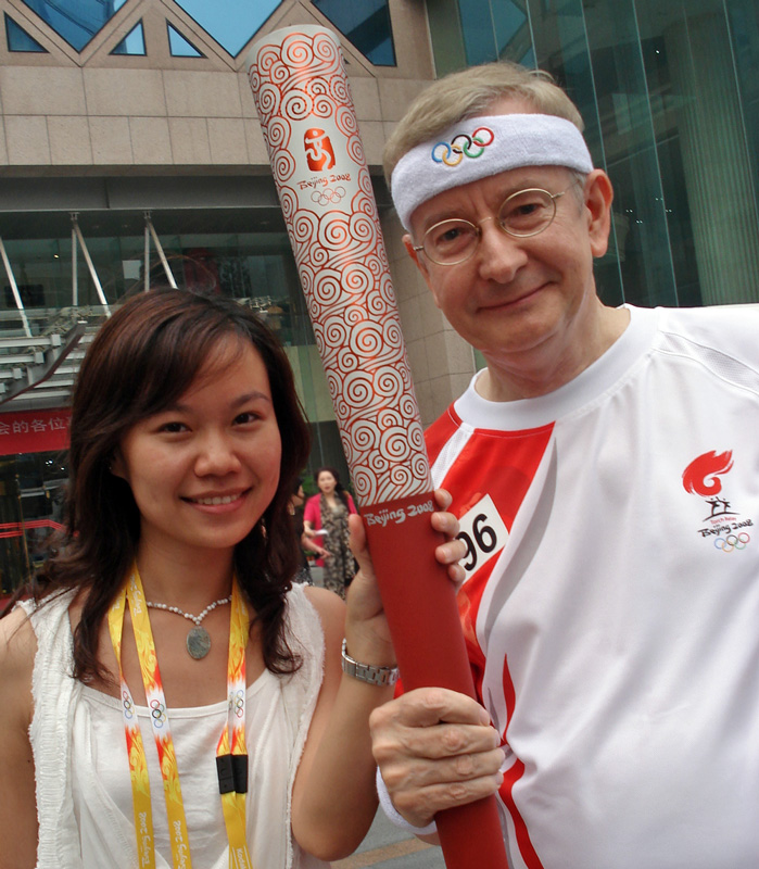 With Mavis Ma and my Olympic torch. This shot was taken shortly before we got on the buses to go to Tiananmen Square.