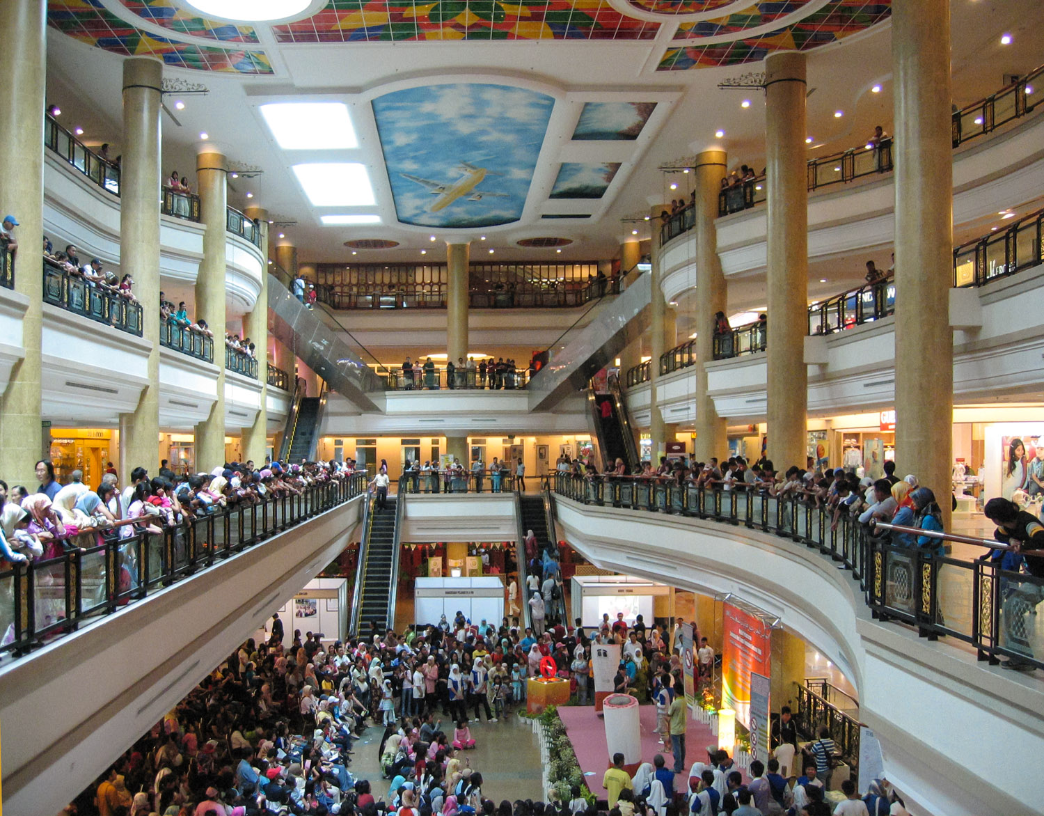 Shoppers watch an event in a Gadong shopping mall. Image:  © Alan Williams