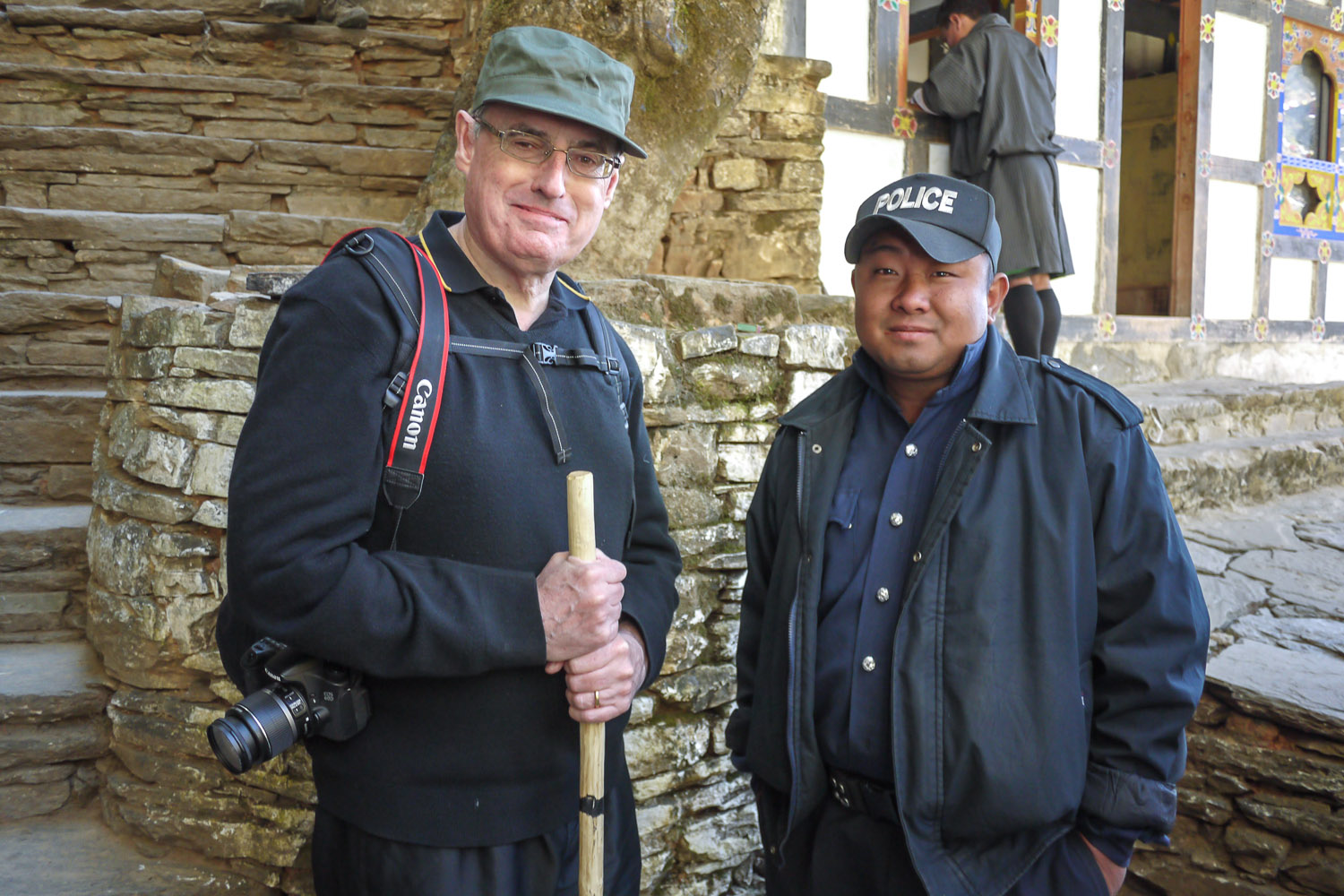 With a friendly policeman at the Tiger's Nest in Bhutan. Image:    © Alan Williams