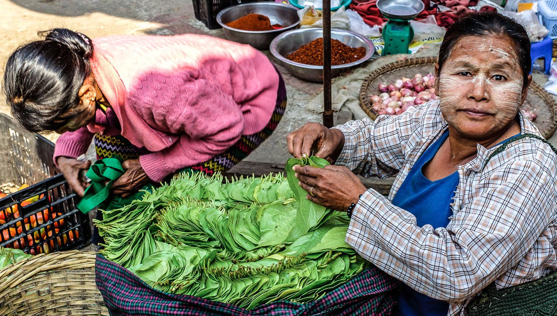 A betel leaf vendor in a Sagaing market, Myanmar. Image:     Allan Harris