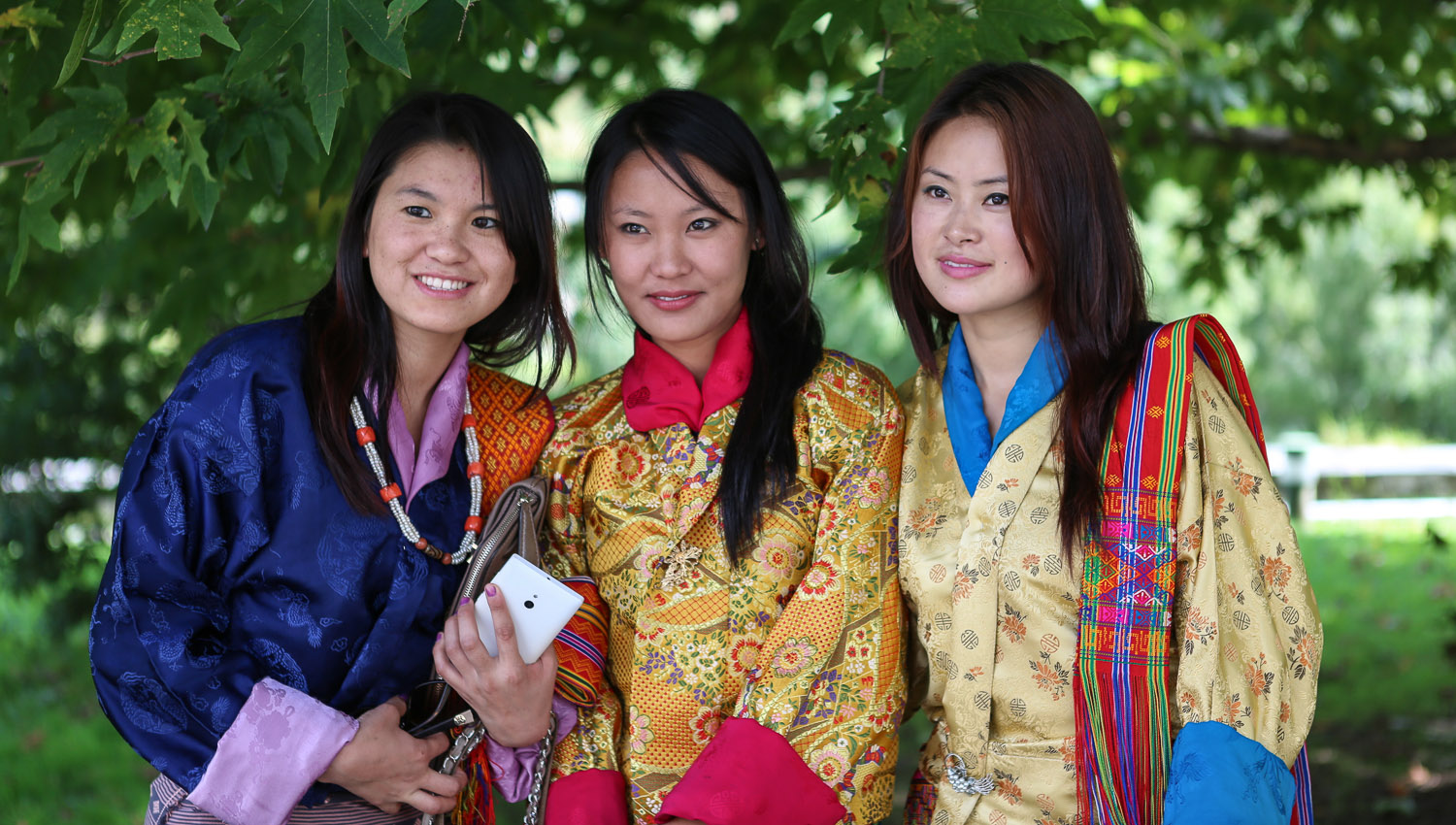 Young Bhutanese women in traditional dress. Image:     Tony Yeoh      Dreamstime