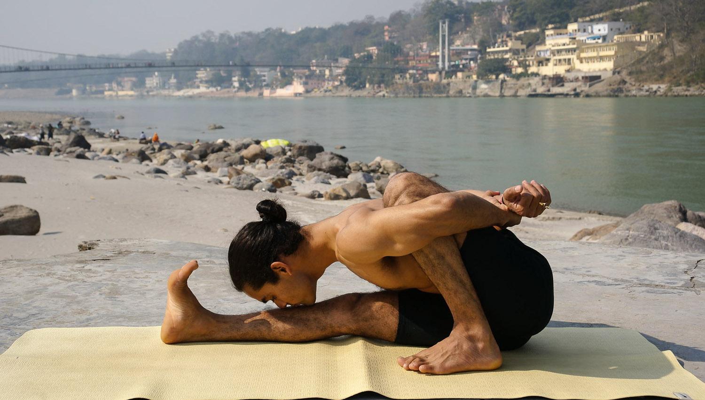 A local yoga practitioner by the river at Rishikesh. Image:     Rishi Krishnatre