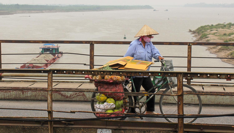 A cyclist carrying produce across the bridge. Image  © Alan Williams