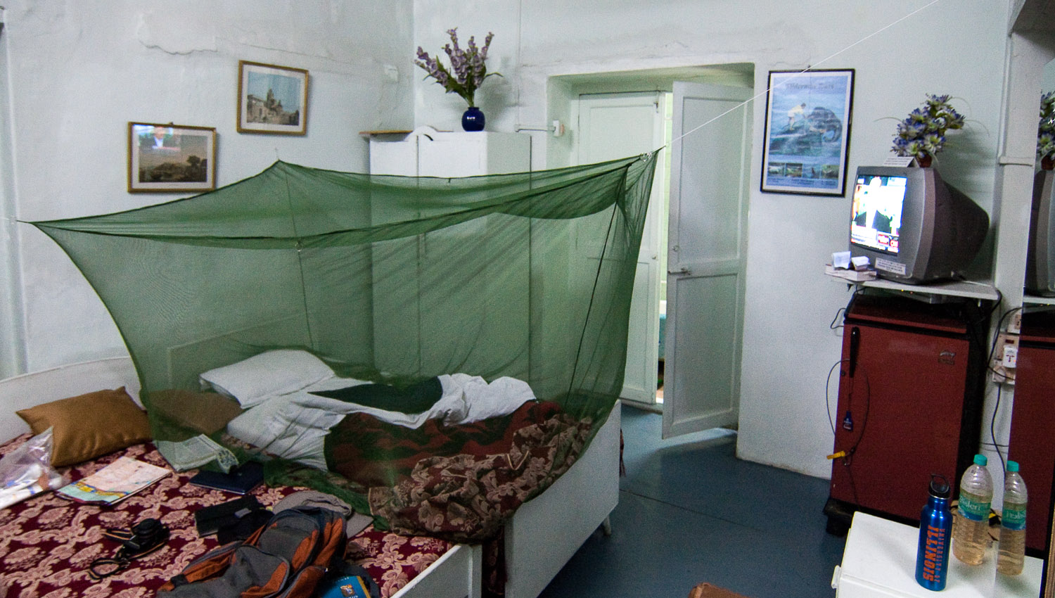 A traveller's own mosquito net in an Indian budget hotel. Image:     Brian Holsclaw