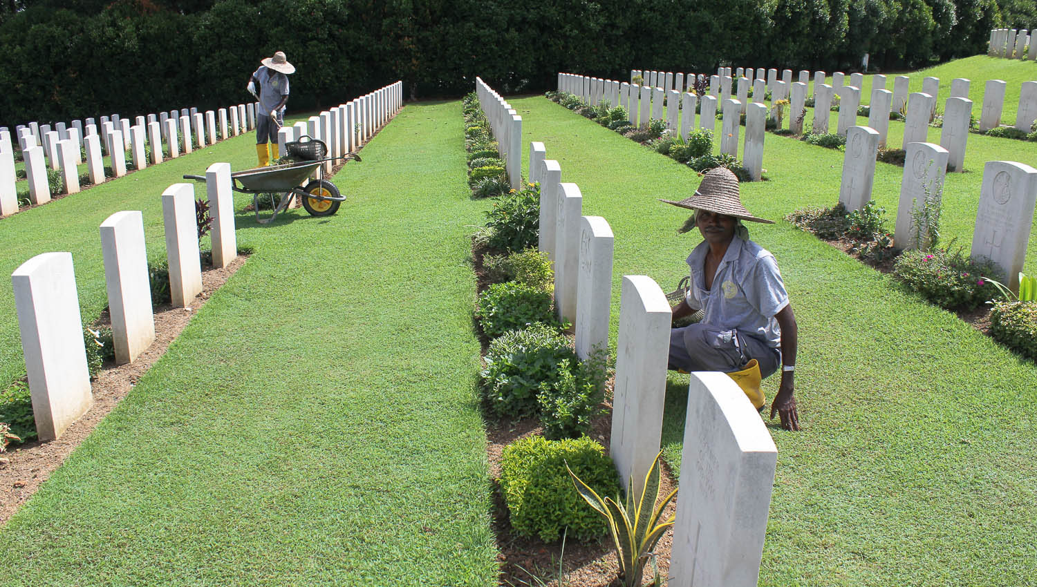 Maintaining the graves at Kranji War Cemetery. Image:  © Alan Williams